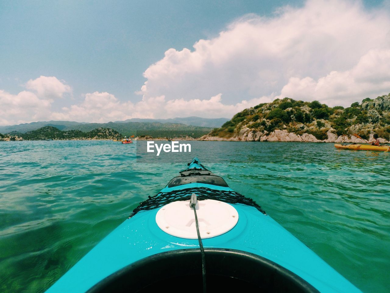 transportation, mode of transportation, nautical vessel, water, sky, cloud - sky, nature, sea, day, beauty in nature, no people, scenics - nature, travel, outdoors, land, turquoise colored, blue, motorboat, non-urban scene