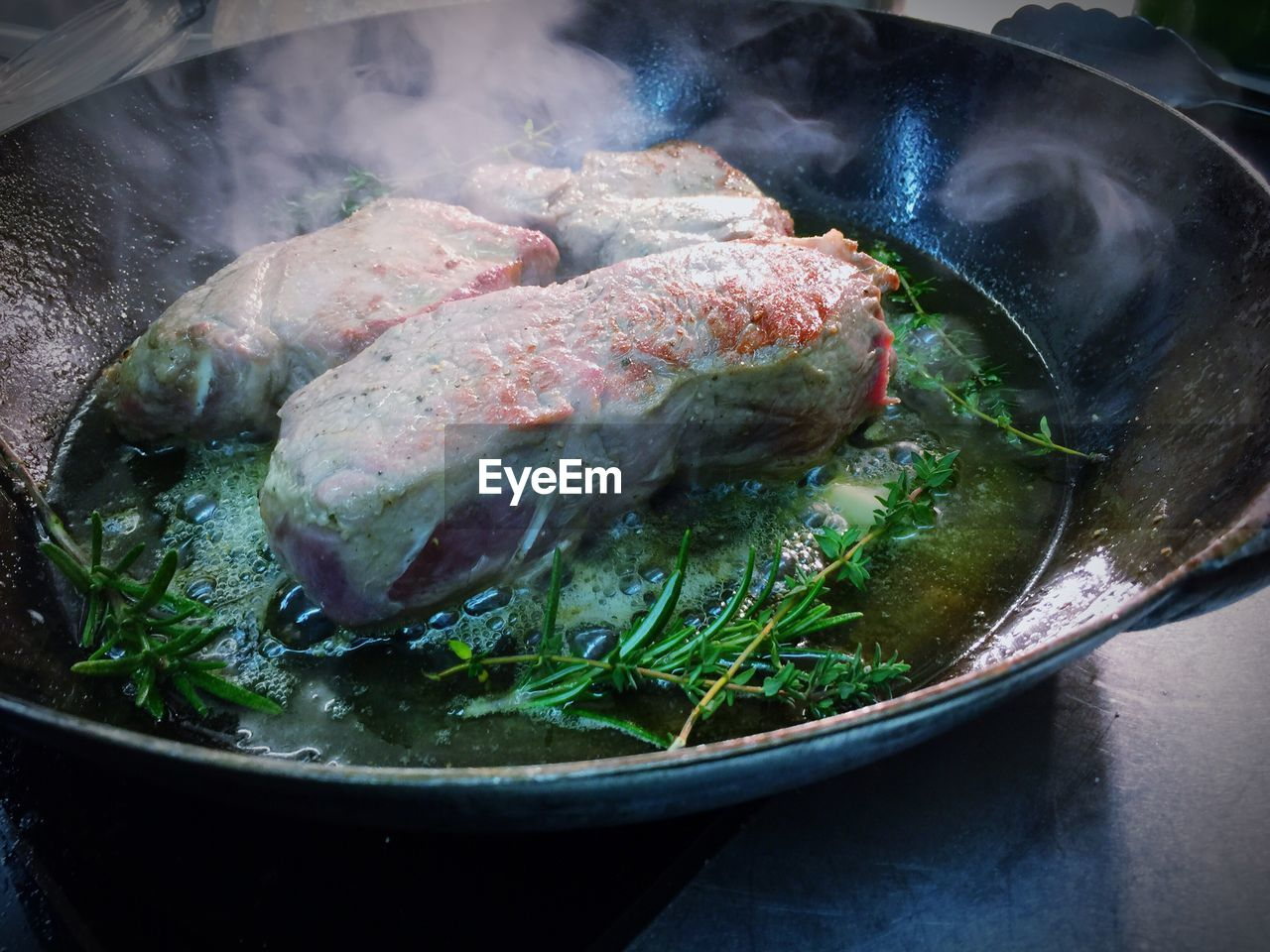 High angle view of beef cooking in pan