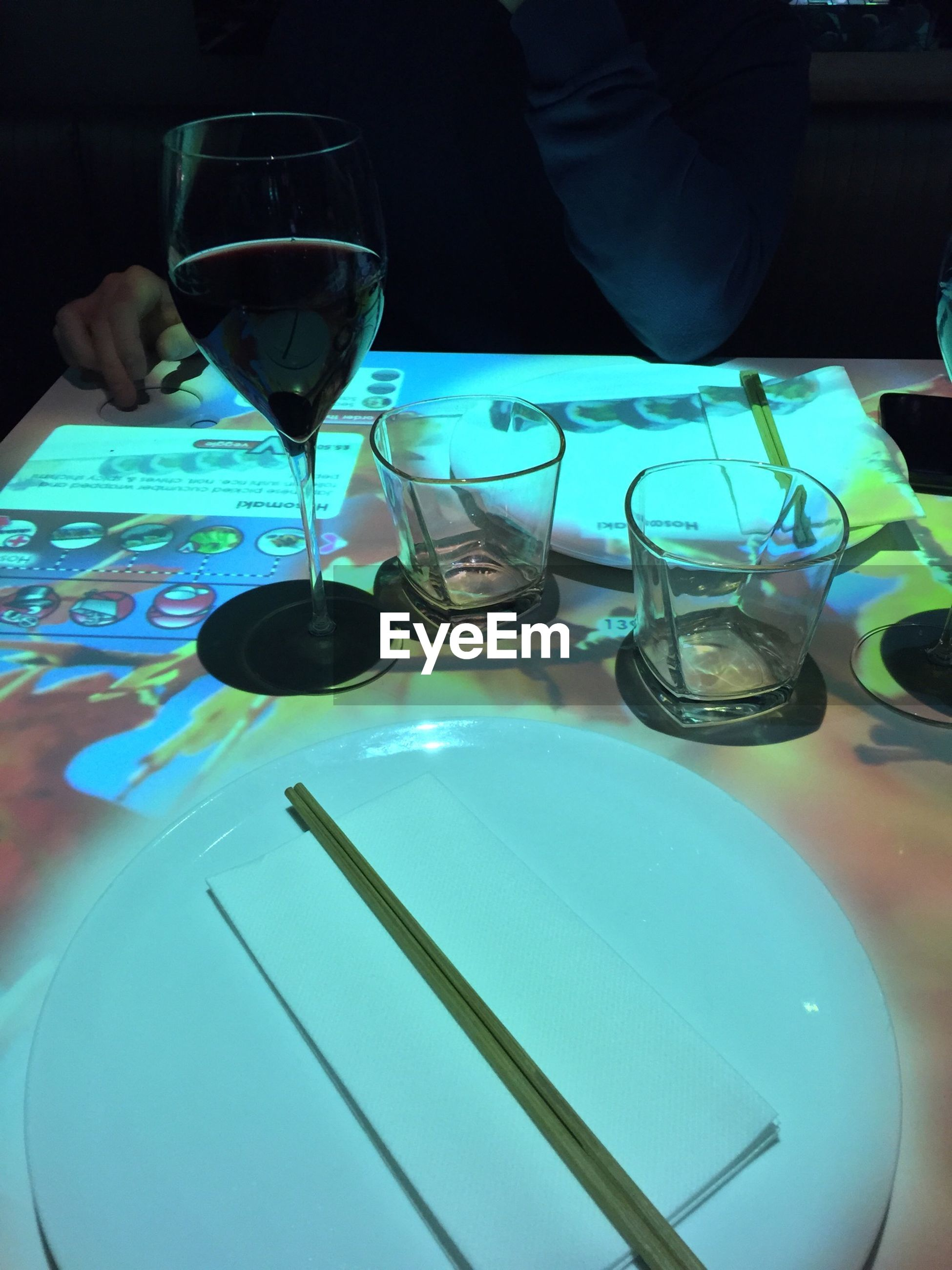 indoors, drink, food and drink, person, table, drinking glass, wineglass, refreshment, glass - material, part of, holding, close-up, alcohol, wine, restaurant, cropped, transparent
