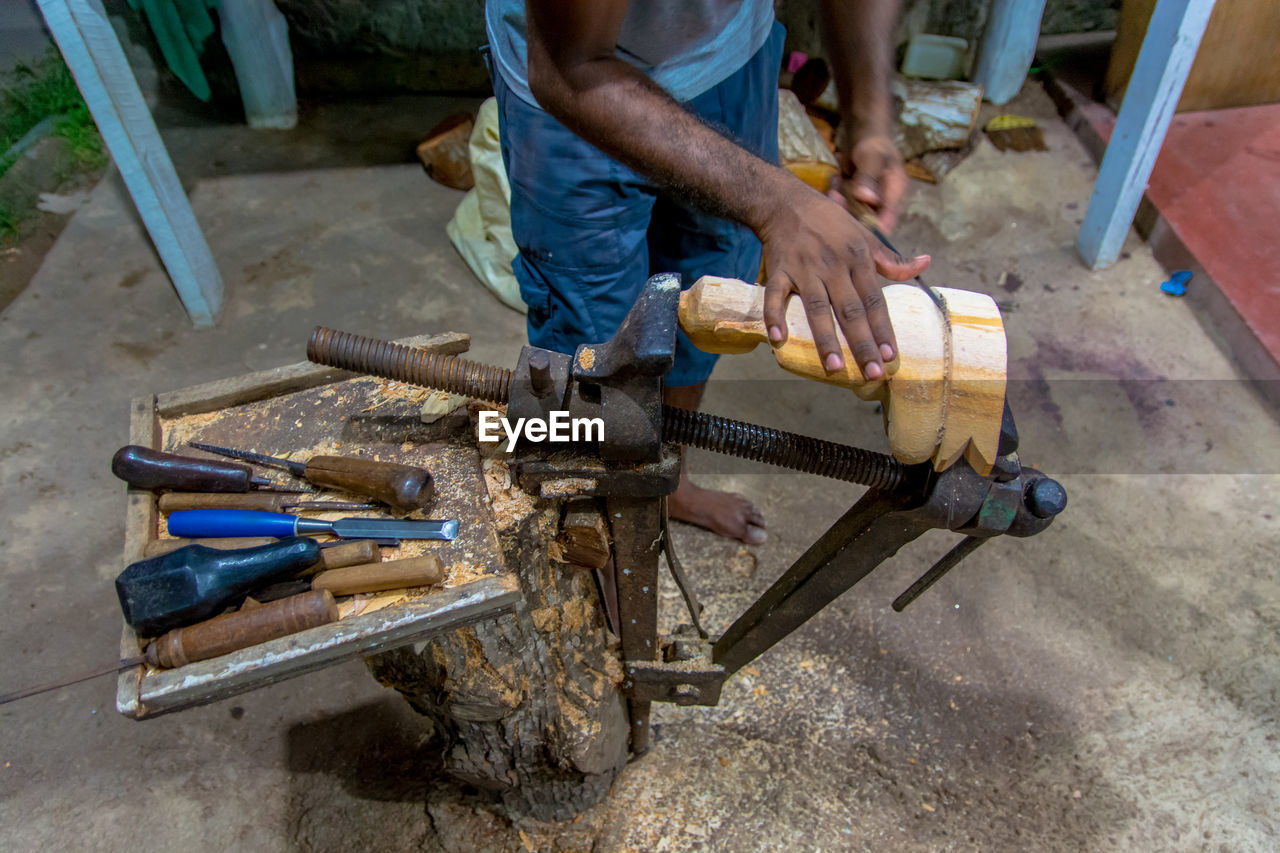 High Angle View Of Man Working On Wood