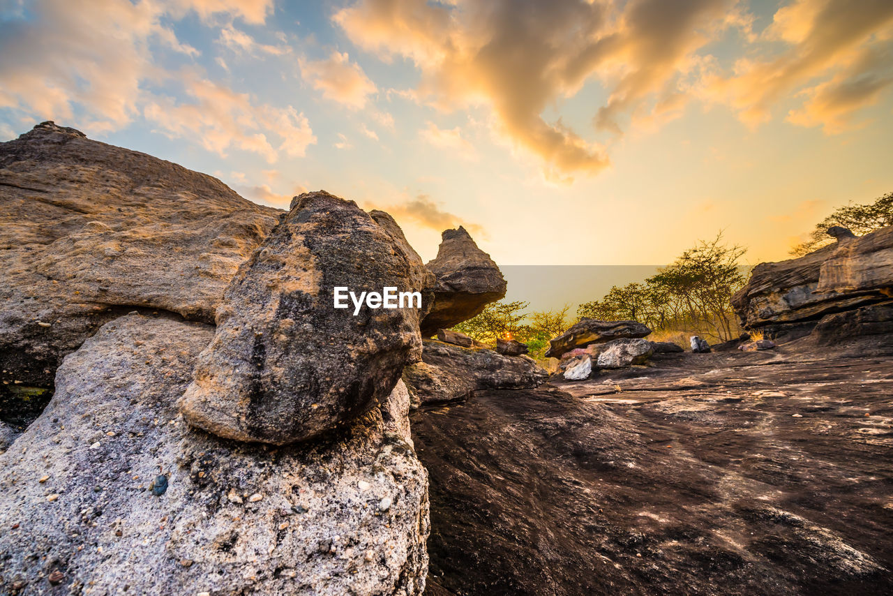 sky, cloud - sky, sunset, rock, rock - object, nature, solid, rock formation, beauty in nature, scenics - nature, tranquility, tree, no people, outdoors, orange color, tranquil scene, non-urban scene, land, plant, sunlight