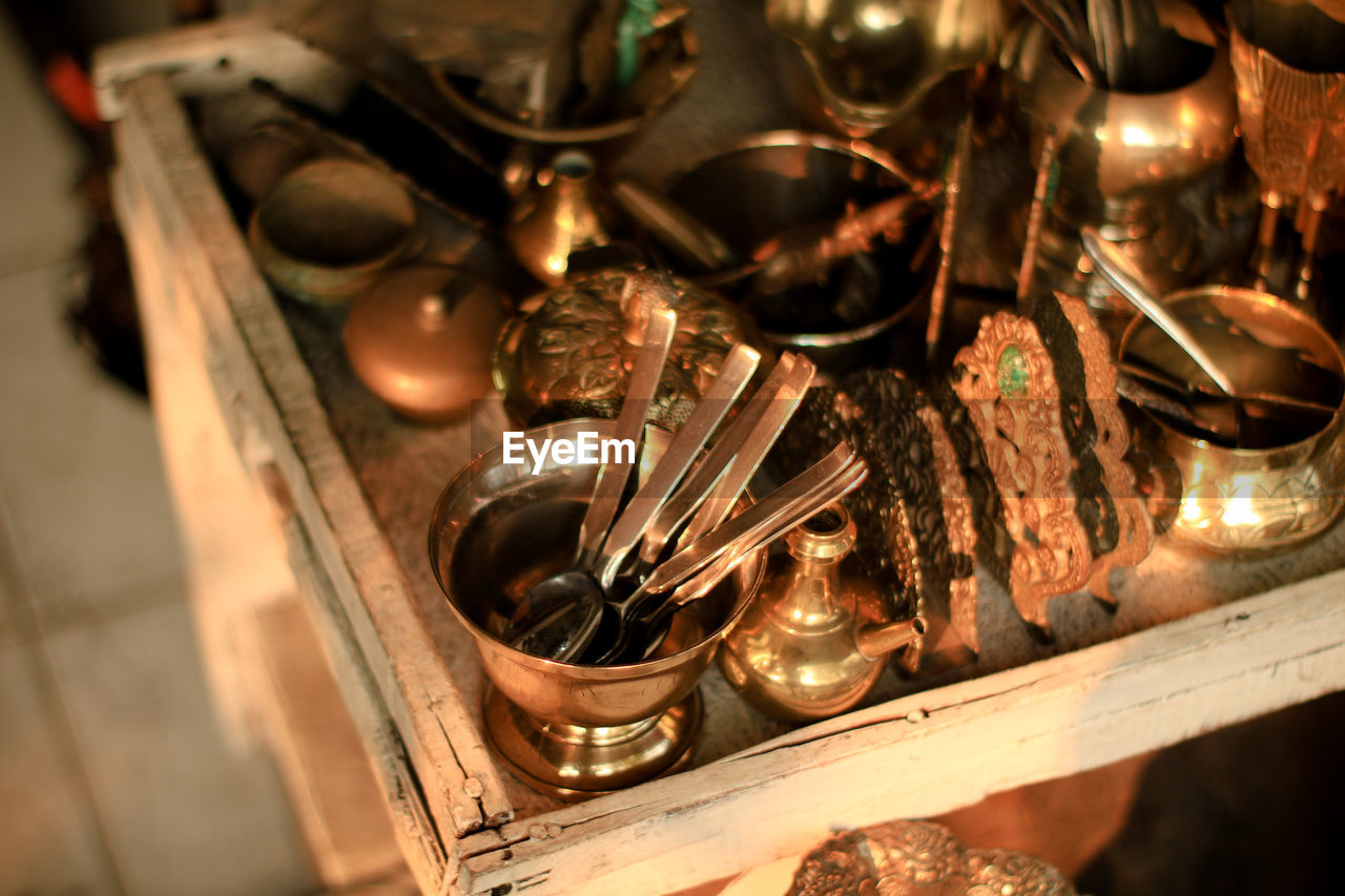 metal, indoors, no people, close-up, fire, old, selective focus, burning, antique, flame, equipment, history, the past, still life, large group of objects, fire - natural phenomenon, architecture, gold colored, high angle view