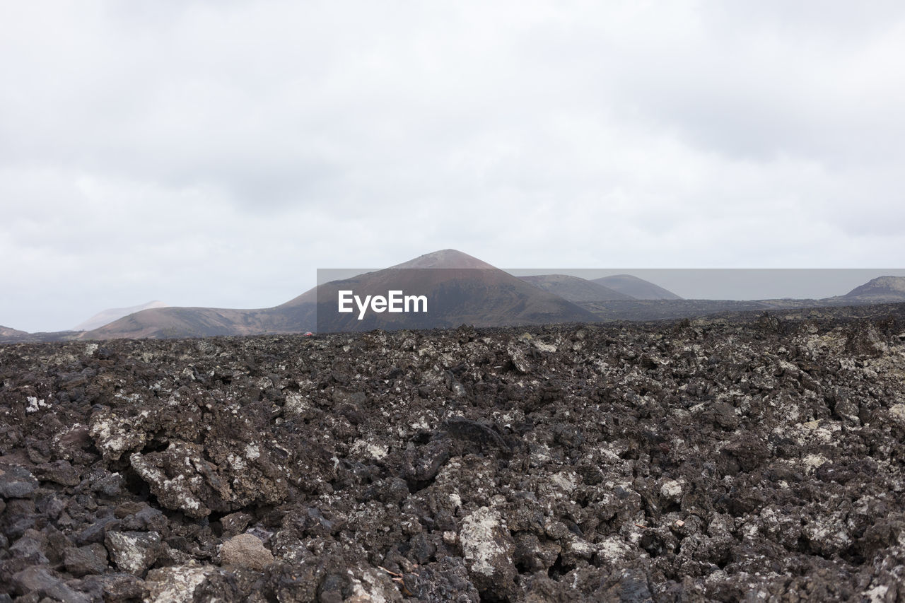 mountain, sky, environment, cloud - sky, beauty in nature, scenics - nature, landscape, tranquil scene, no people, tranquility, day, nature, non-urban scene, land, geology, outdoors, volcano, mountain range, physical geography, rock, arid climate, mountain peak