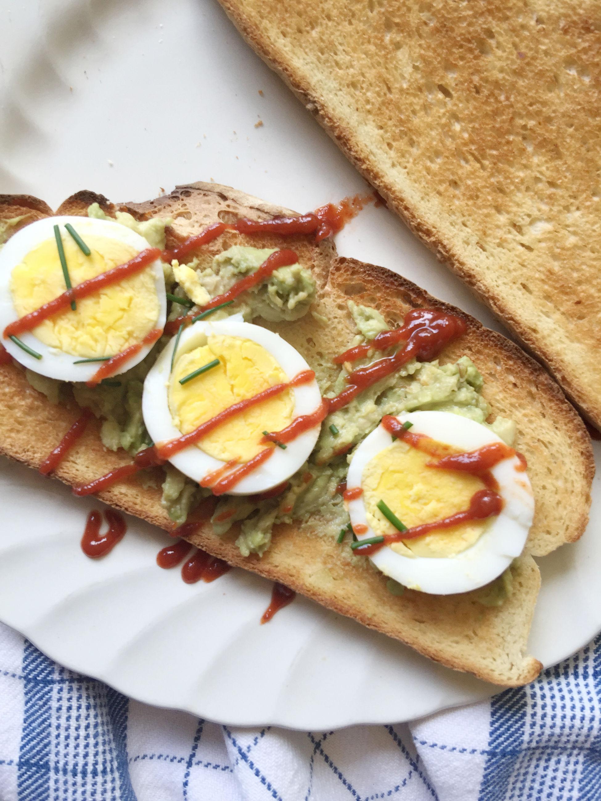 High angle view of avocado and egg sandwich