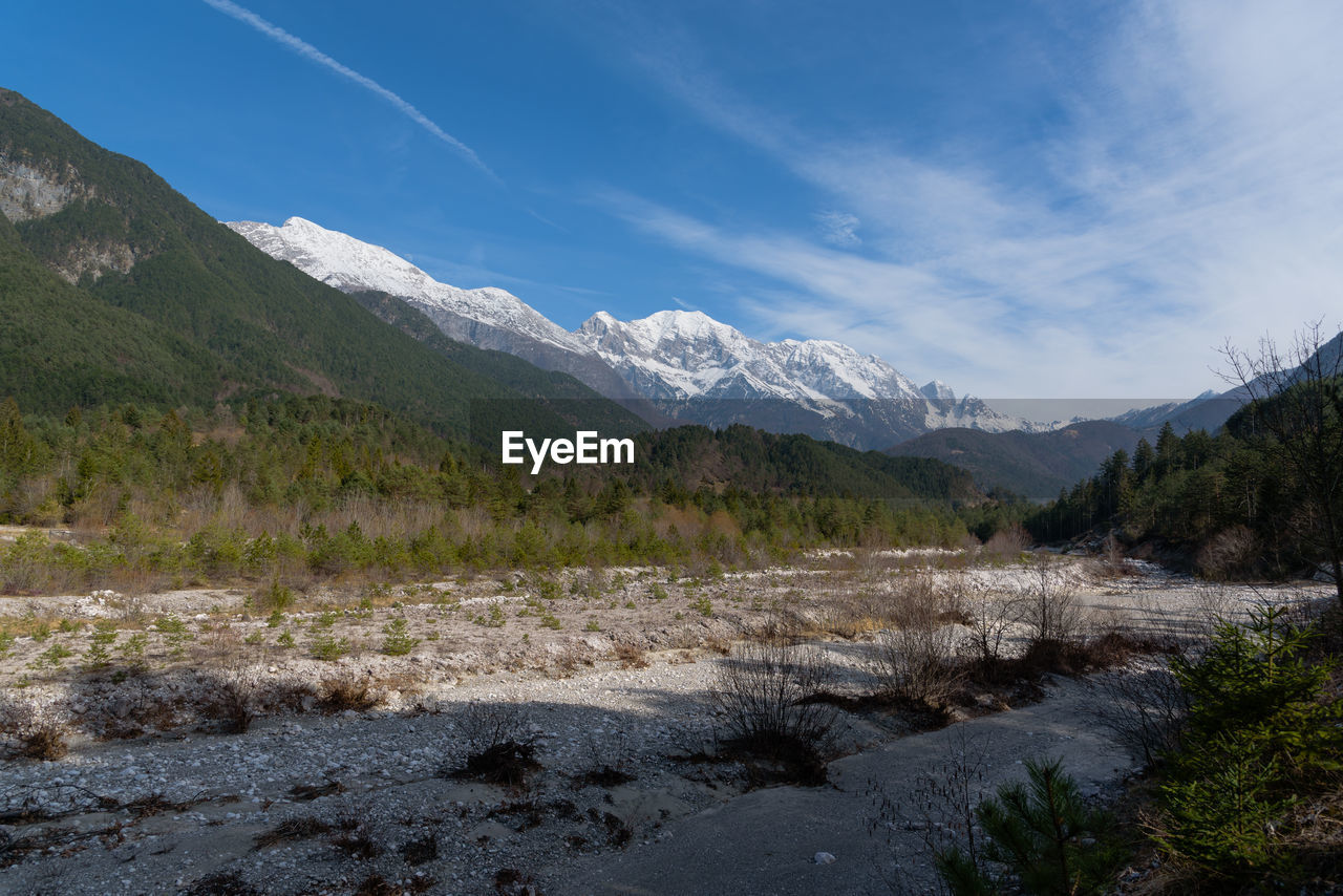 sky, mountain, environment, landscape, nature, water, beauty in nature, snow, scenics - nature, tranquil scene, no people, cloud - sky, tranquility, wilderness, plant, land, cold temperature, day, scenery, mountain peak, snowcapped mountain, mountain range