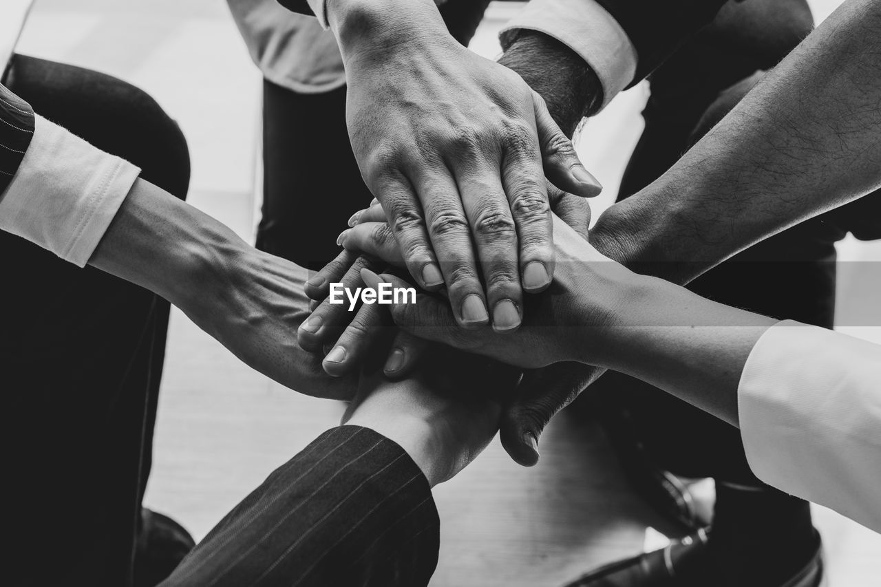 Group of people stacking hands