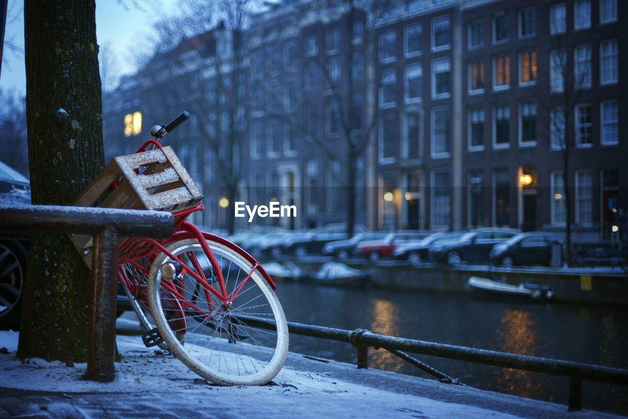 Bicycle In City At Night