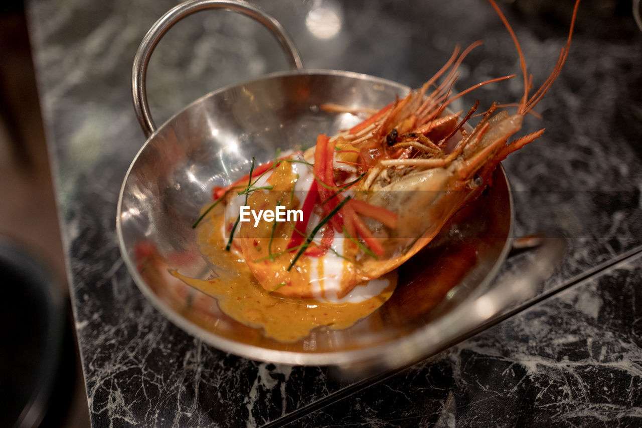 seafood, food, crustacean, food and drink, indoors, kitchen utensil, freshness, close-up, wellbeing, healthy eating, no people, household equipment, high angle view, ready-to-eat, preparation, prawn, meat, smoke - physical structure, still life, spoon, lobster, preparing food