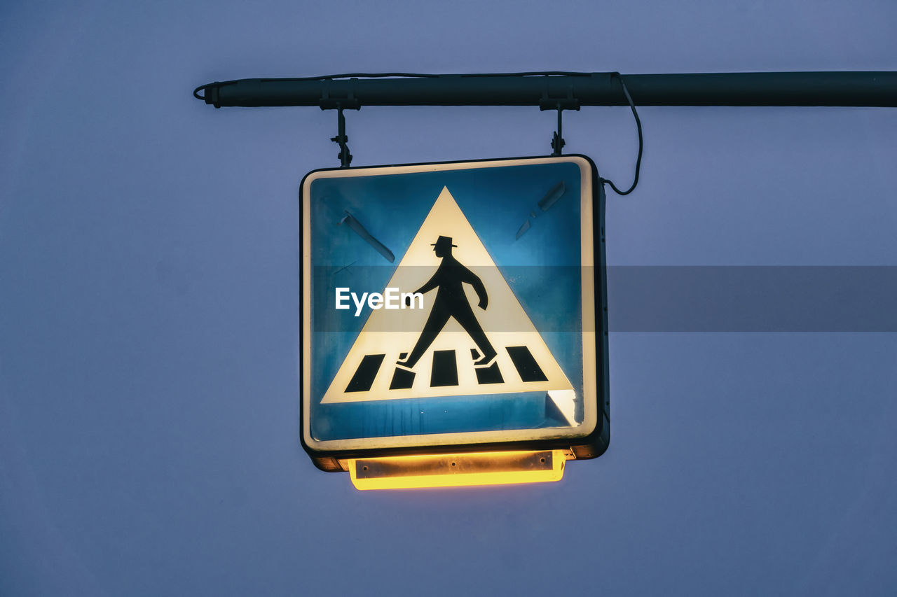 sign, blue, communication, representation, road sign, human representation, sky, clear sky, guidance, transportation, warning sign, pedestrian crossing sign, day, no people, yellow, road, low angle view, information, outdoors, shape, warning symbol