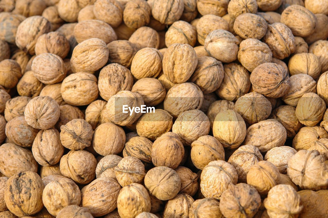 food and drink, food, large group of objects, freshness, full frame, abundance, healthy eating, walnut, backgrounds, nut, wellbeing, nut - food, no people, market, brown, close-up, still life, nutshell, retail, market stall