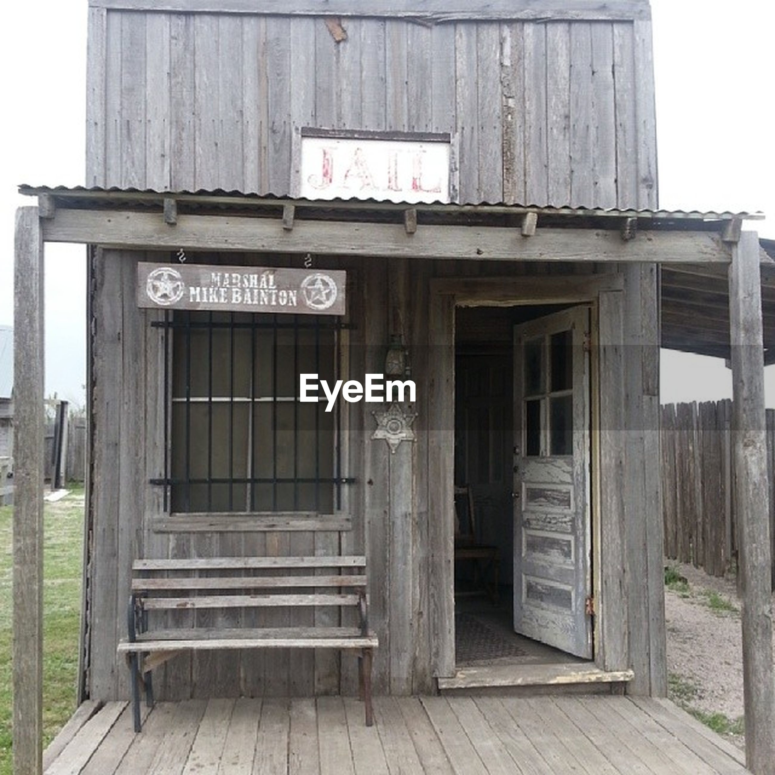 text, architecture, building exterior, built structure, western script, door, wood - material, communication, entrance, closed, wooden, old, non-western script, window, day, gate, house, outdoors, information, wood