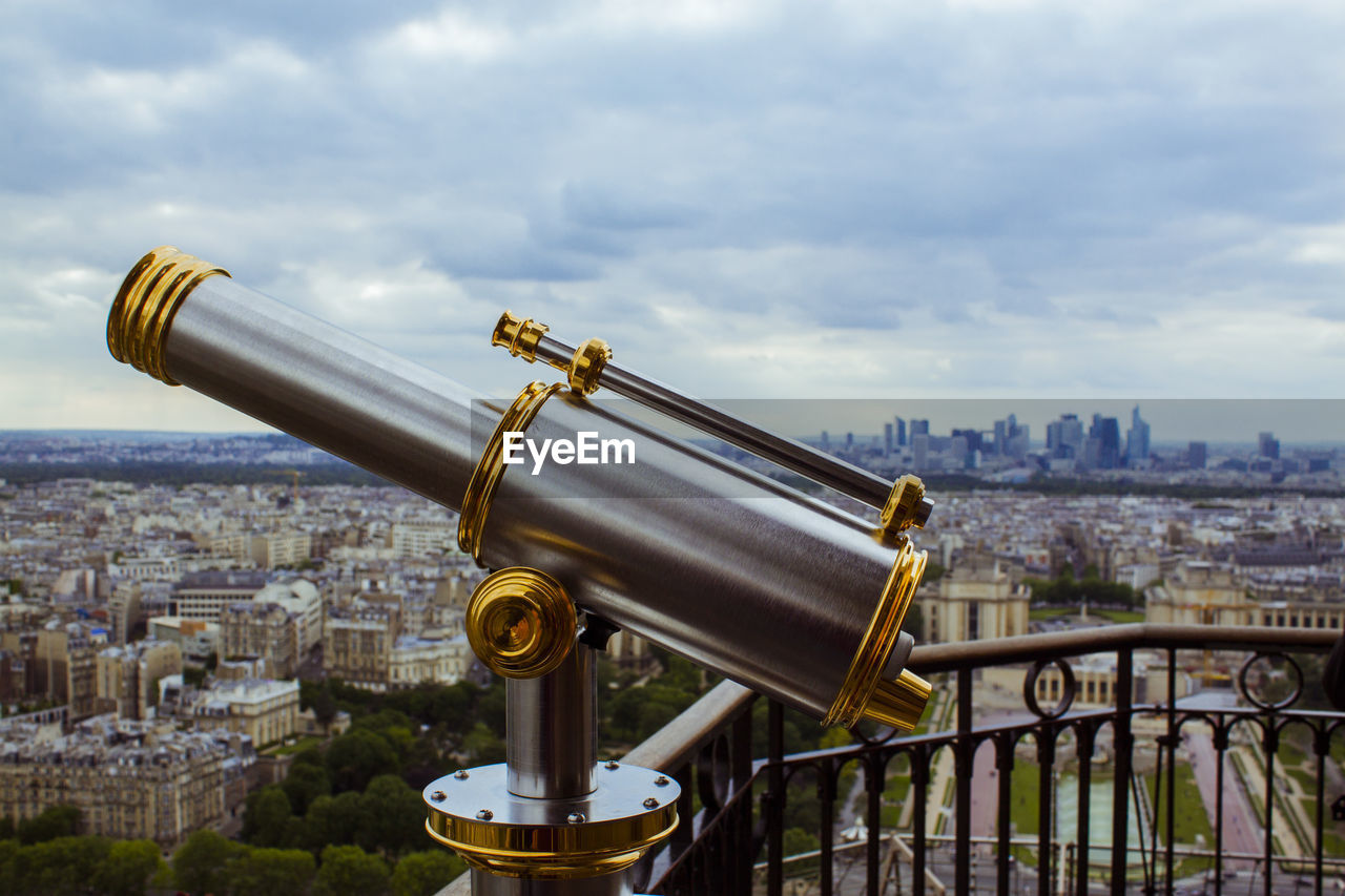 coin-operated binoculars, cityscape, coin operated, city, hand-held telescope, telescope, architecture, sky, surveillance, cloud - sky, metal, built structure, building exterior, travel destinations, no people, tourism, outdoors, day, discovery, close-up
