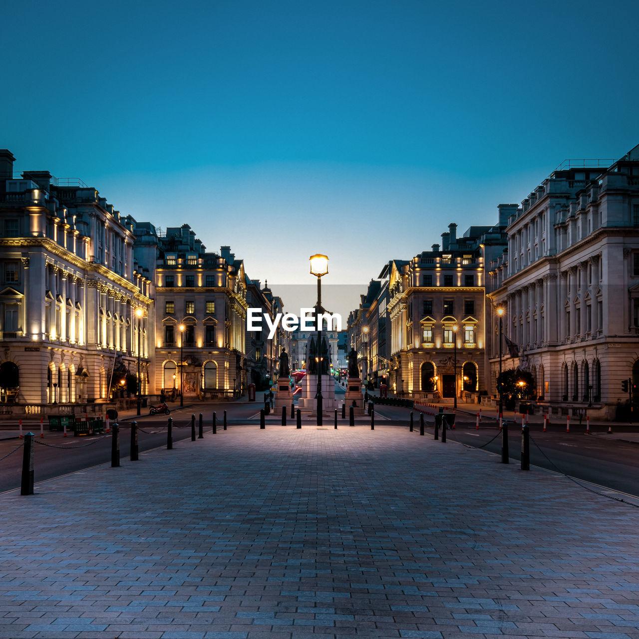 Illuminated street in london at twilight