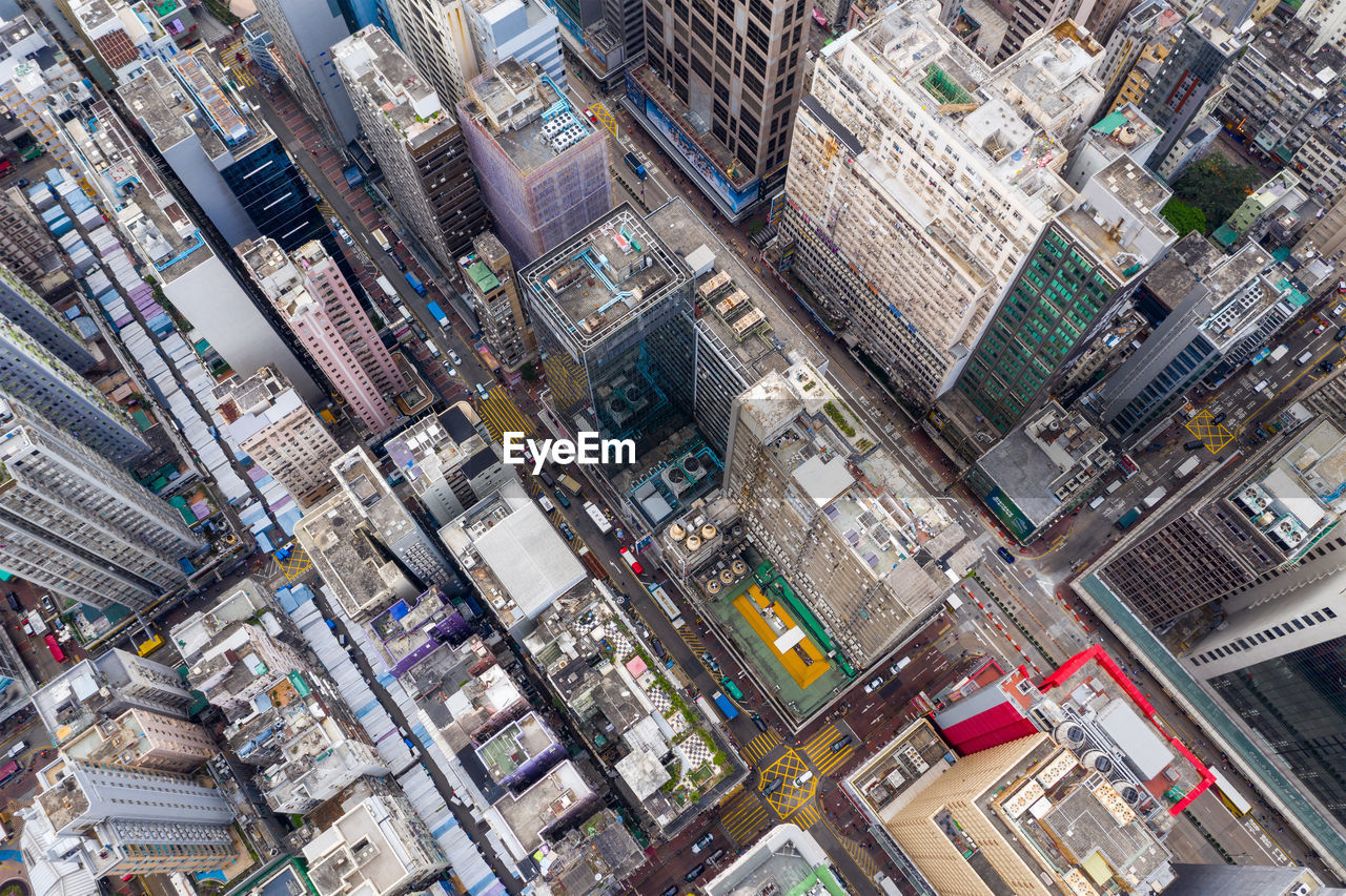 building exterior, architecture, city, built structure, building, high angle view, residential district, cityscape, crowd, day, crowded, skyscraper, aerial view, office building exterior, outdoors, travel destinations, tilt, street, city life, apartment