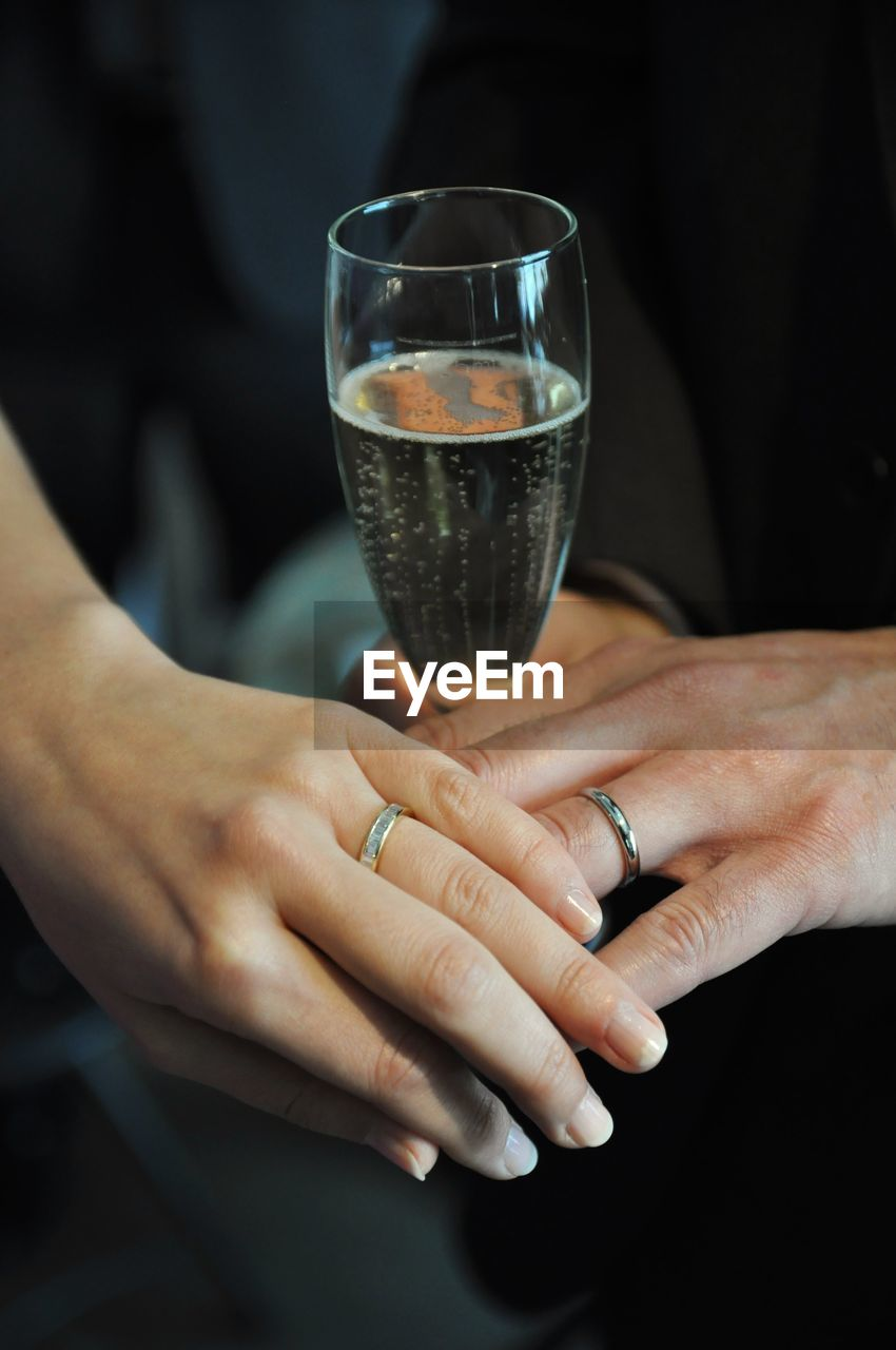Bride And Groom Showing Off Wedding Rings