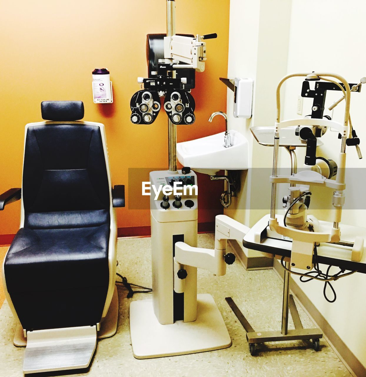 Empty chair with eye test equipment at clinic