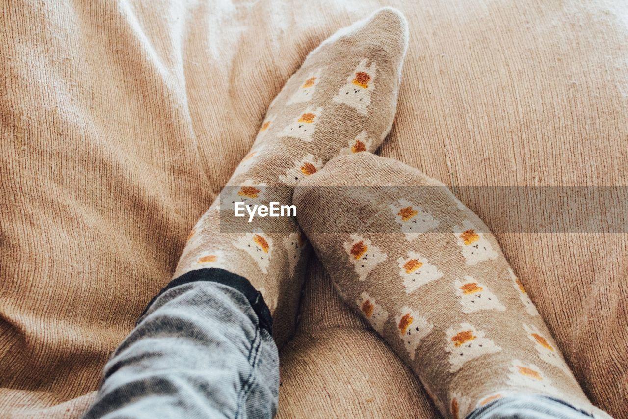 Feet of A Person Wearing Socks