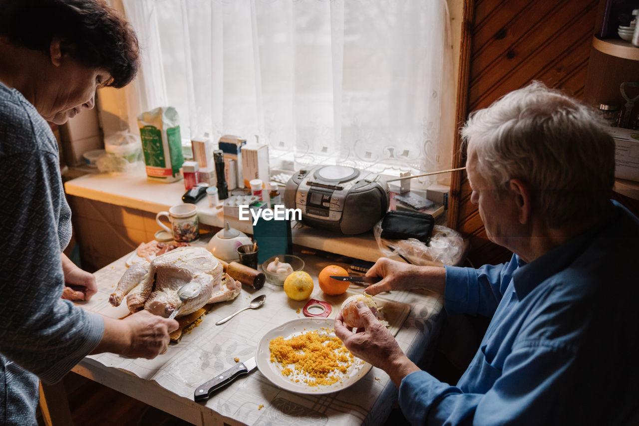 PEOPLE EATING FOOD ON TABLE