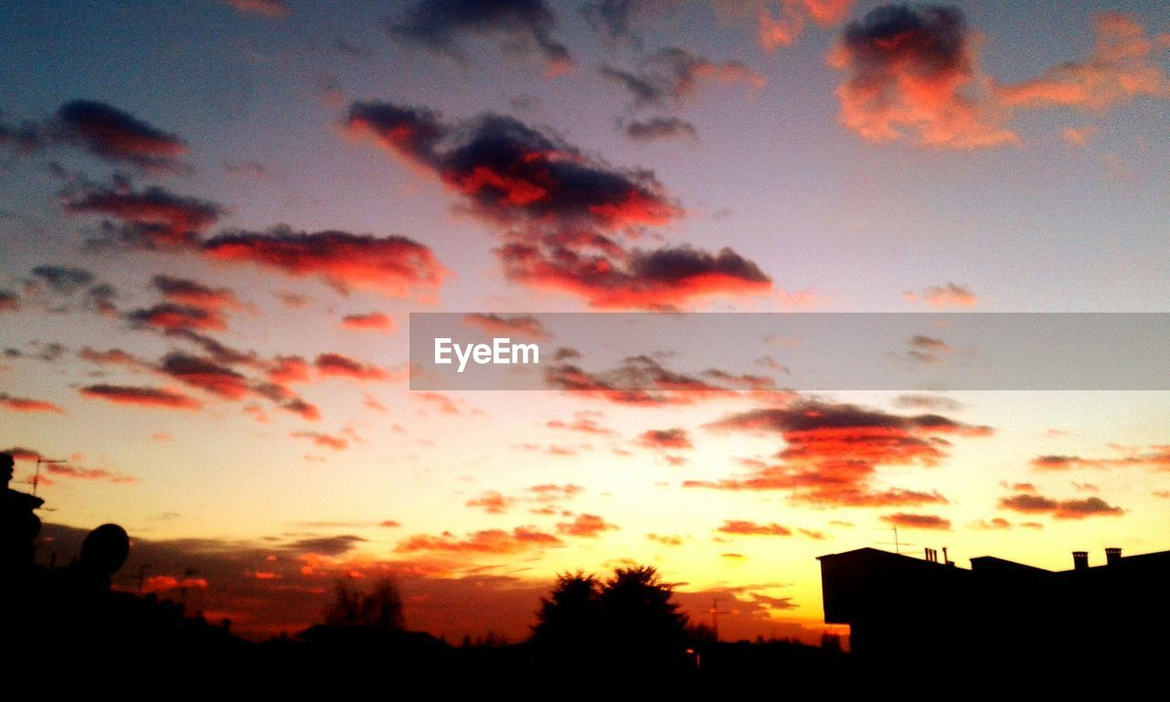sunset, silhouette, sky, orange color, cloud - sky, building exterior, built structure, dramatic sky, beauty in nature, architecture, no people, nature, low angle view, outdoors, scenics, tranquil scene, city, tranquility, tree, travel destinations