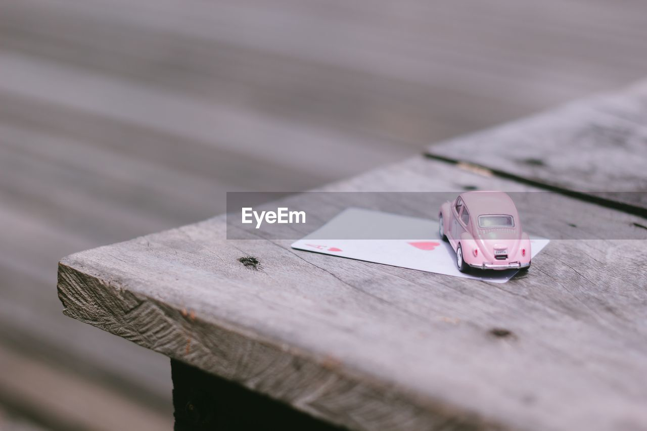 High angle view of toy car and card on table