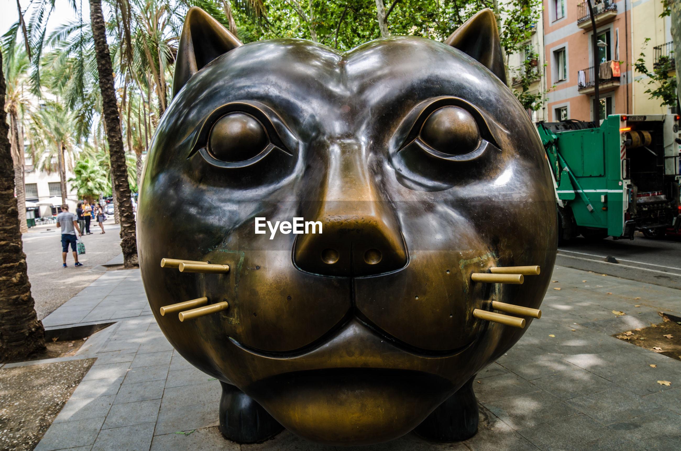 Large cat sculpture in city