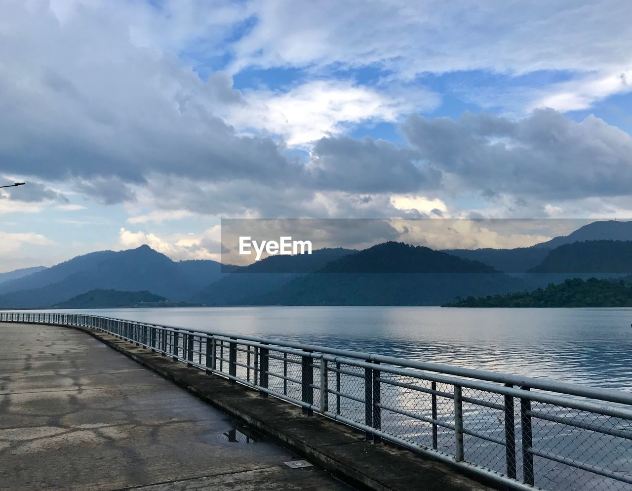 mountain, water, cloud - sky, sky, scenics - nature, beauty in nature, mountain range, tranquil scene, tranquility, railing, nature, lake, non-urban scene, no people, day, idyllic, outdoors, architecture, built structure