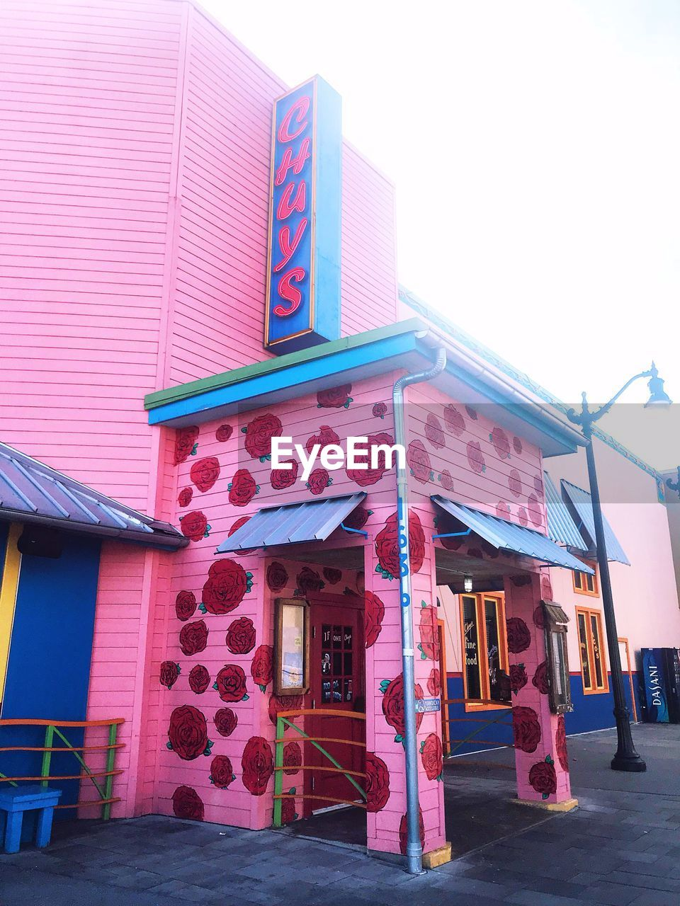 built structure, architecture, building exterior, pink color, outdoors, day, no people, clear sky, multi colored, awning