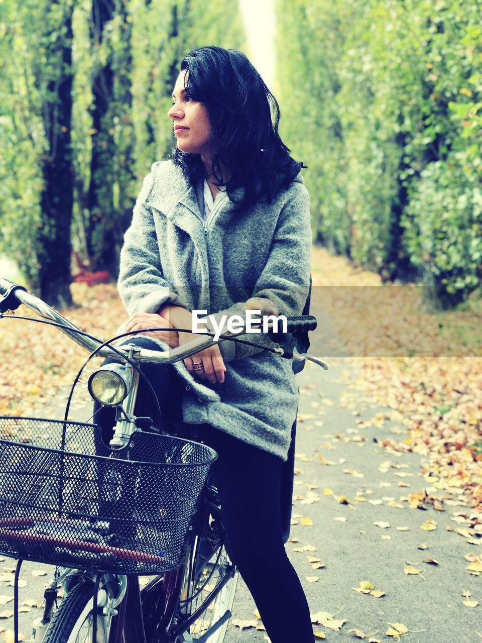 bicycle, real people, tree, one person, transportation, nature, young adult, plant, day, lifestyles, leisure activity, focus on foreground, casual clothing, land, young women, autumn, women, three quarter length, outdoors, hairstyle