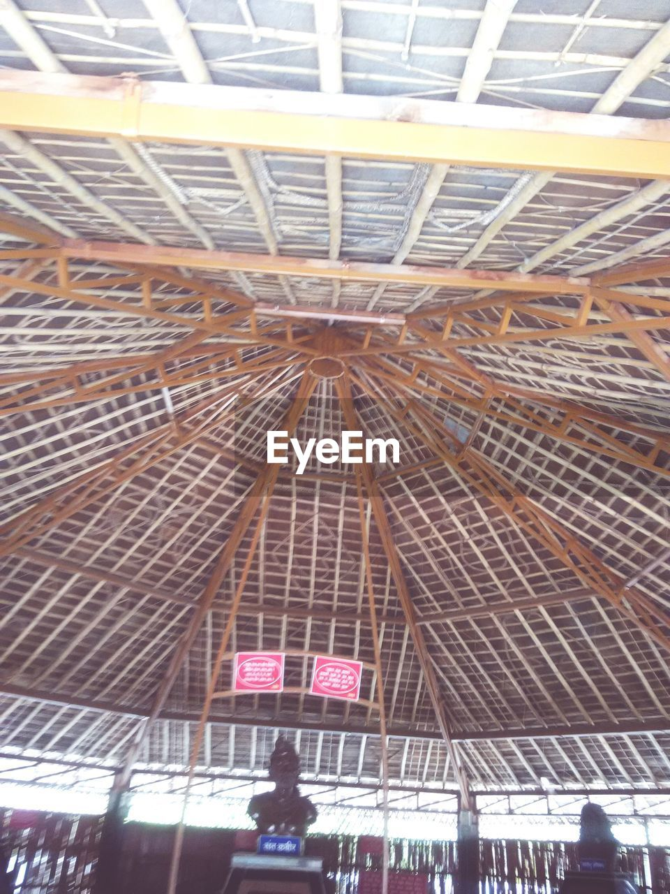 indoors, low angle view, ceiling, real people, architecture, built structure, day, men, one person, people