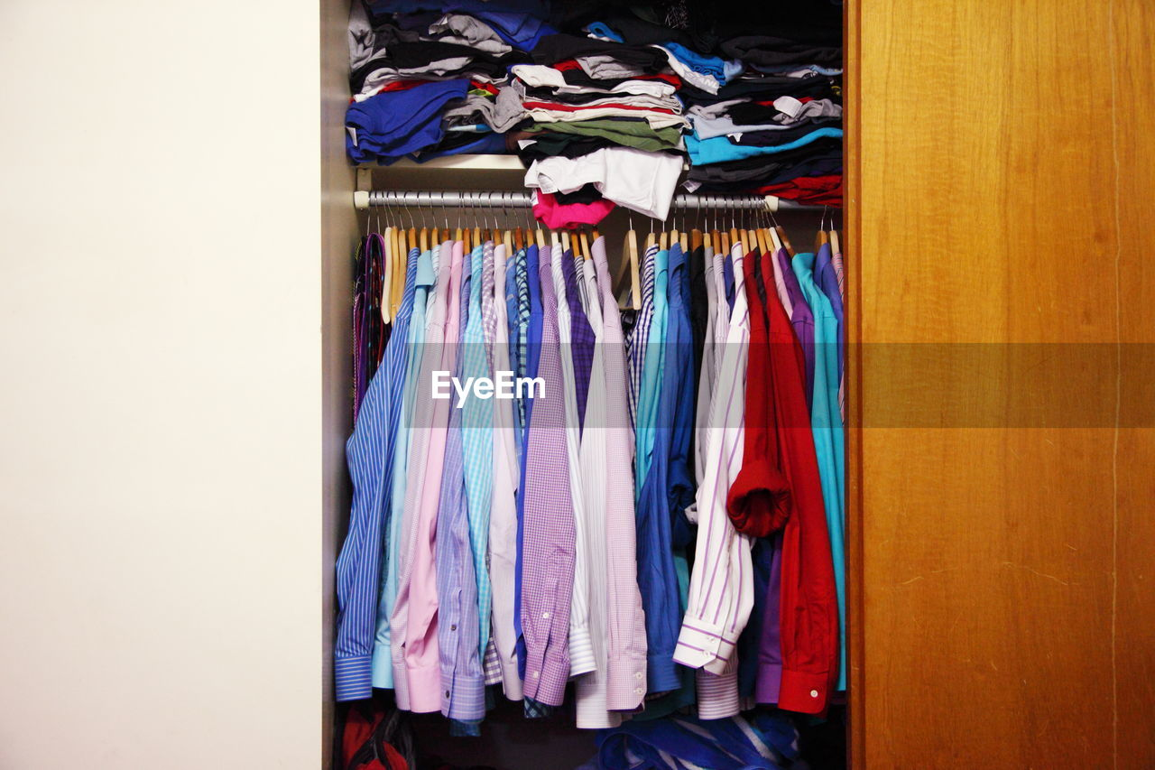 Colorful Shirts Hanging In Closet At Home