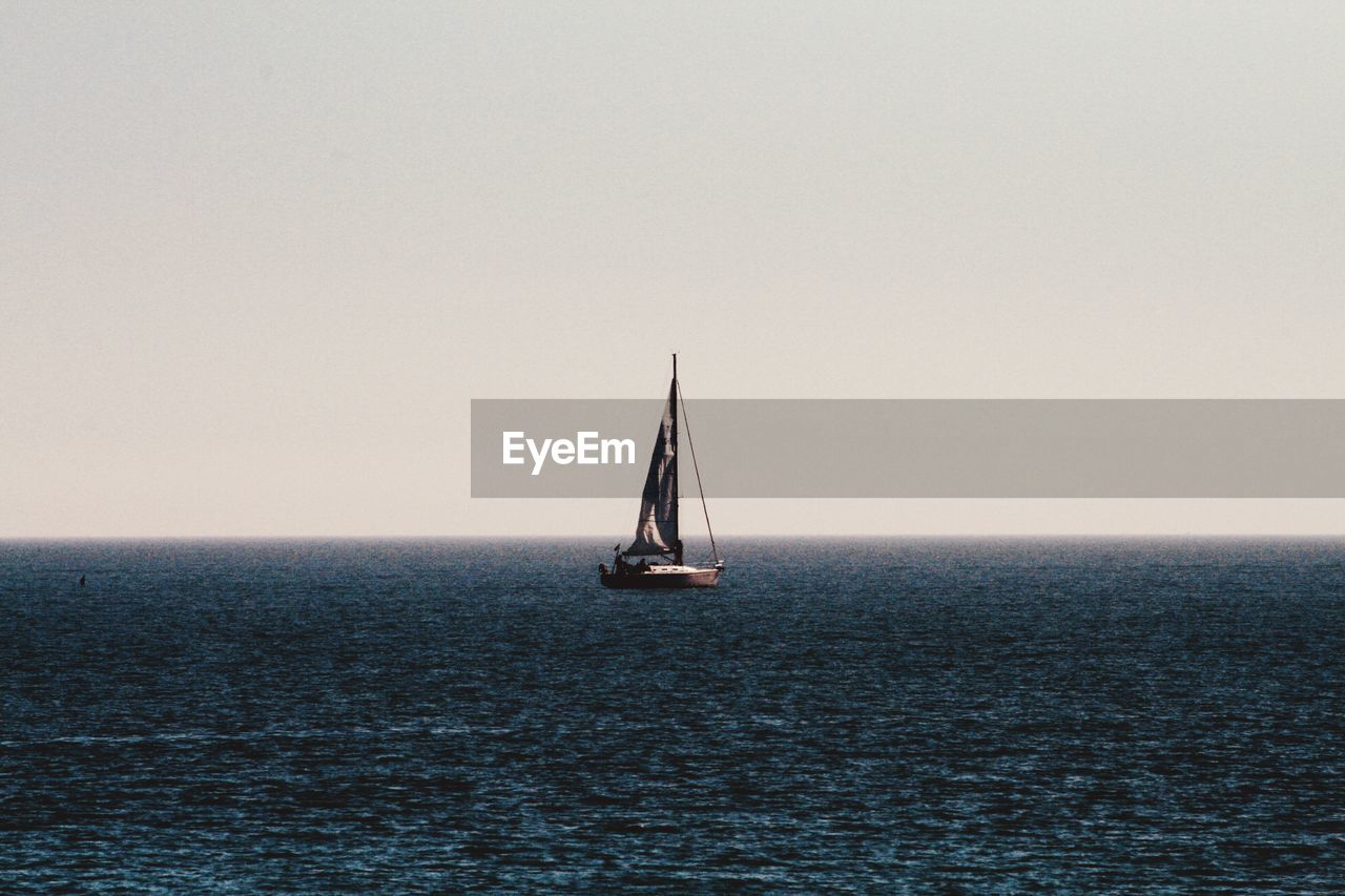 water, sea, horizon over water, horizon, sky, waterfront, sailboat, copy space, nautical vessel, scenics - nature, clear sky, sailing, mode of transportation, transportation, beauty in nature, tranquility, nature, tranquil scene, canvas, no people, luxury, yacht, yachting