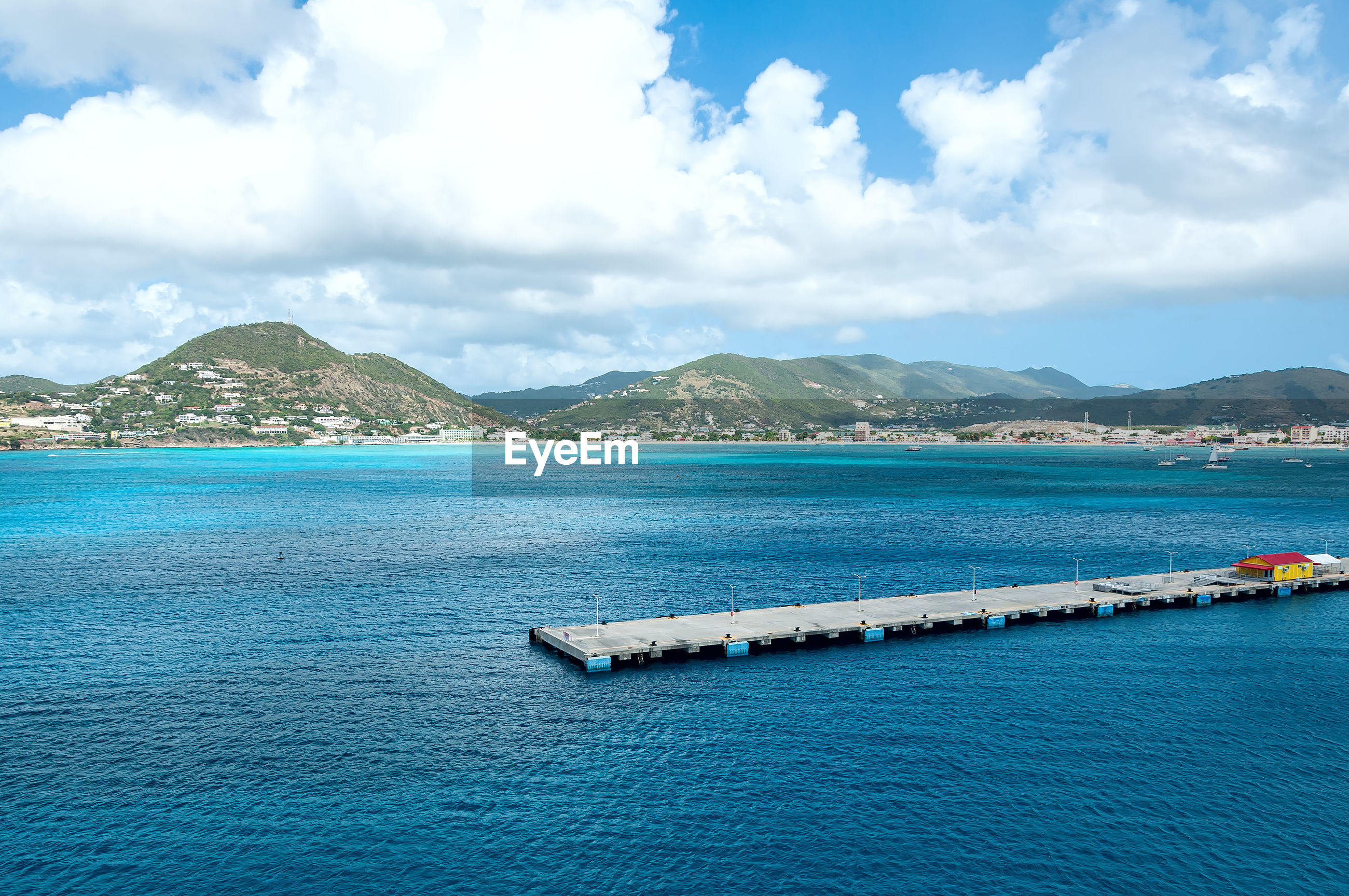 SCENIC VIEW OF BAY AGAINST SKY