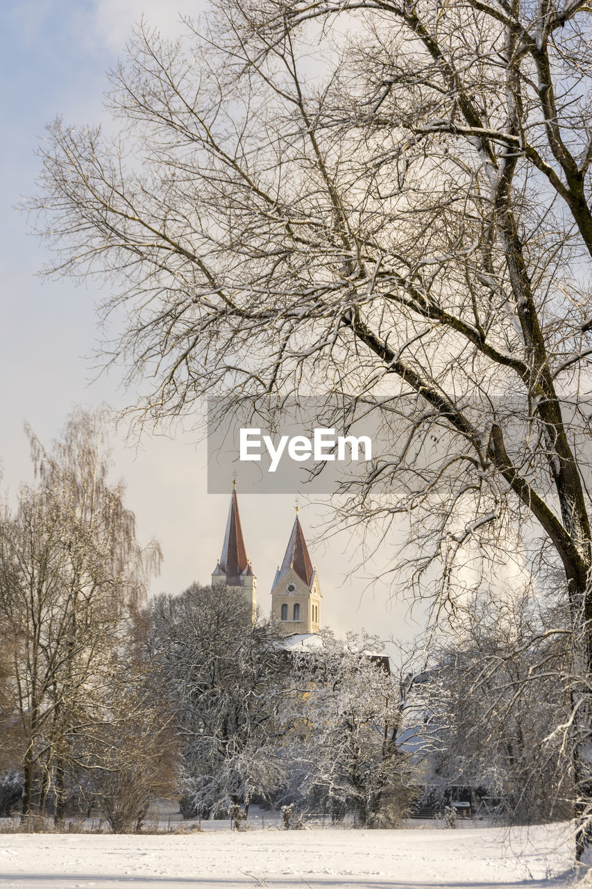 tree, built structure, building exterior, architecture, cold temperature, plant, snow, place of worship, religion, winter, belief, spirituality, building, sky, bare tree, nature, no people, outdoors, spire