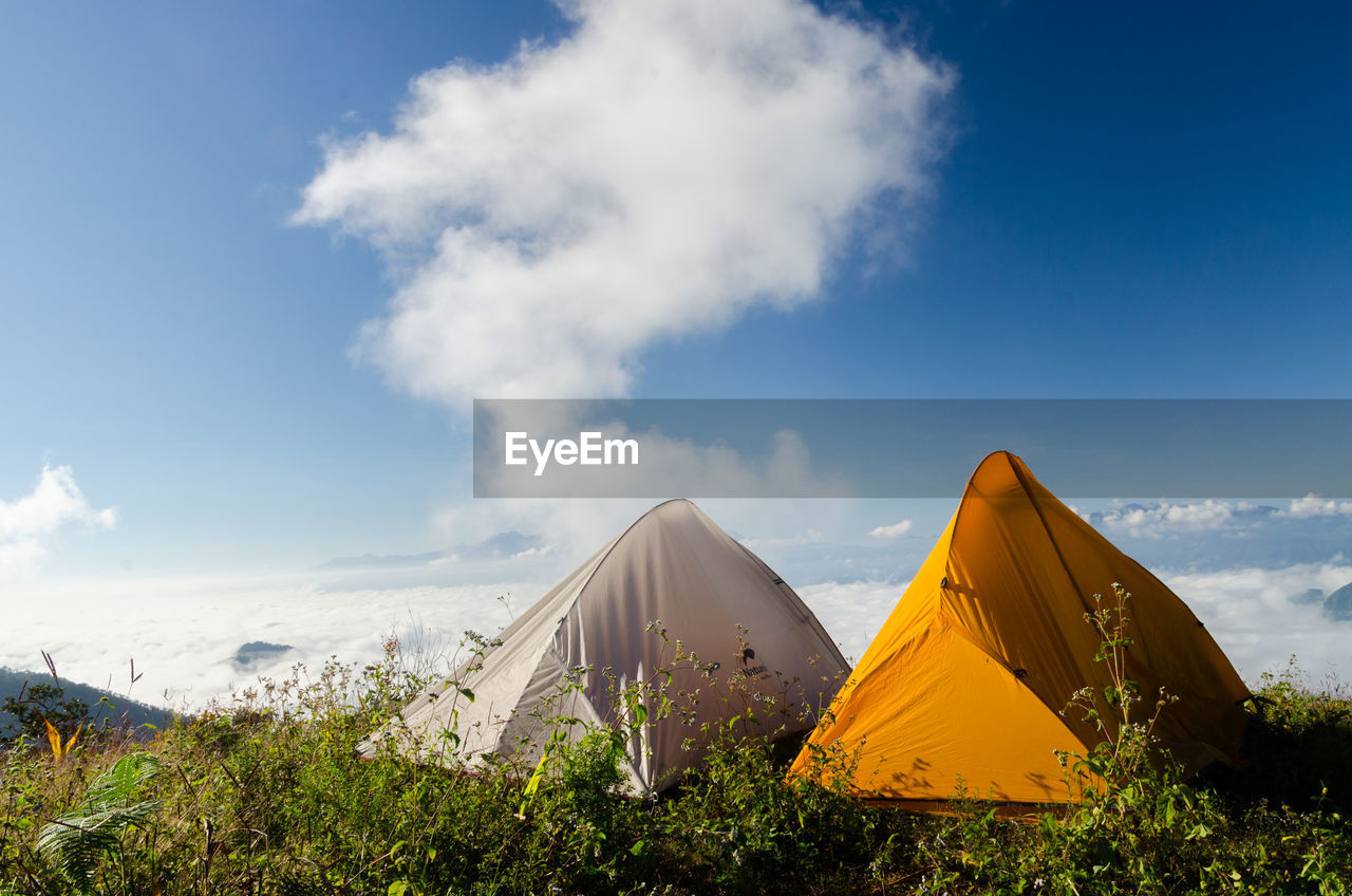 Tents On Mountain Against Sky