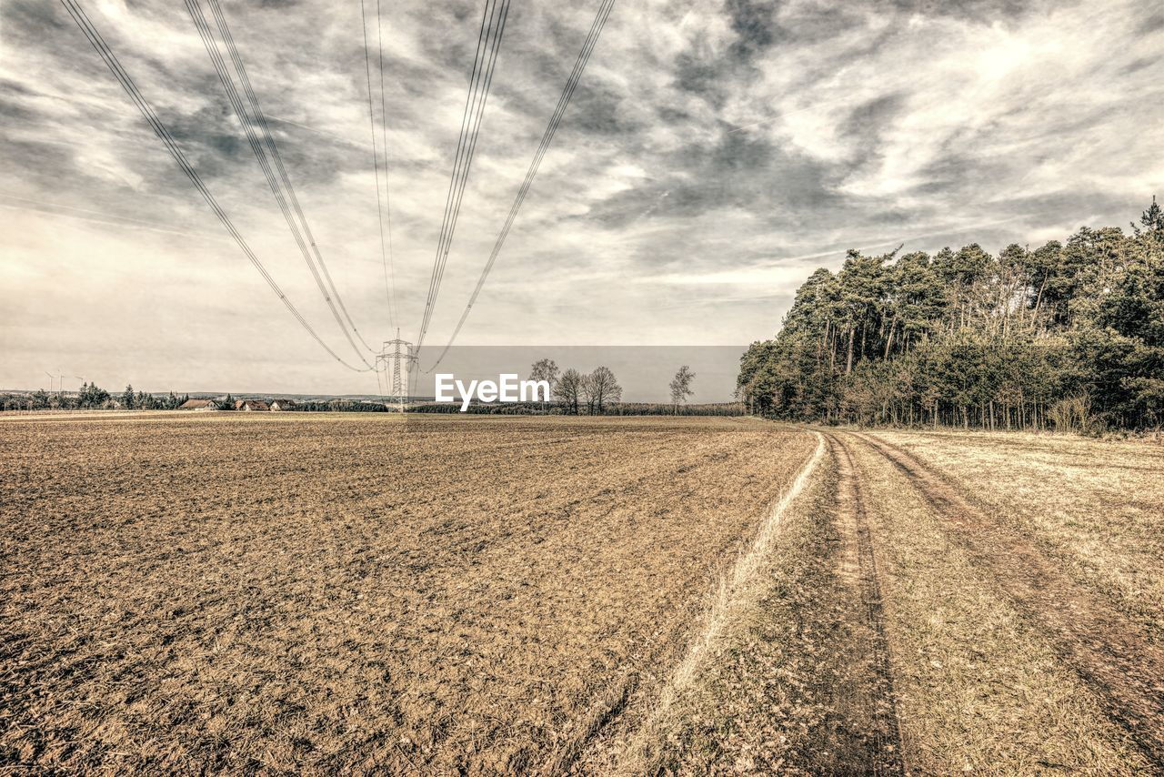 sky, cloud - sky, tree, land, field, plant, landscape, electricity pylon, environment, tranquil scene, cable, nature, tranquility, electricity, no people, agriculture, power line, scenics - nature, rural scene, beauty in nature, outdoors, power supply
