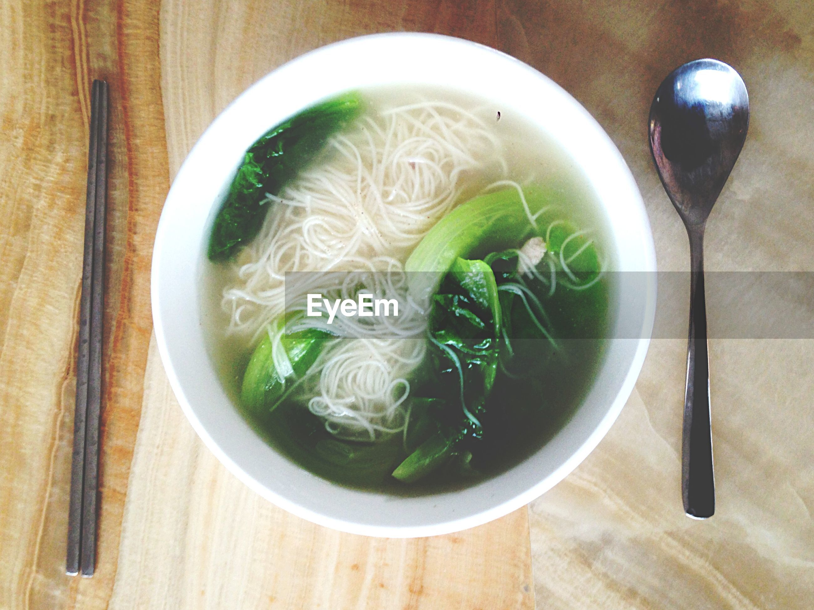 food and drink, indoors, freshness, food, bowl, table, healthy eating, ready-to-eat, soup, plate, still life, directly above, meal, serving size, noodles, high angle view, spoon, chopsticks, close-up, served