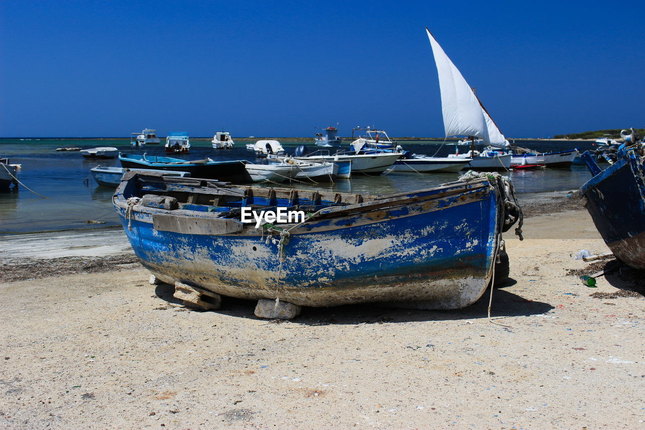 nautical vessel, transportation, mode of transportation, water, sky, sea, moored, nature, beach, land, clear sky, day, no people, sand, outdoors, blue, travel, tranquility, scenics - nature, fishing boat, rowboat