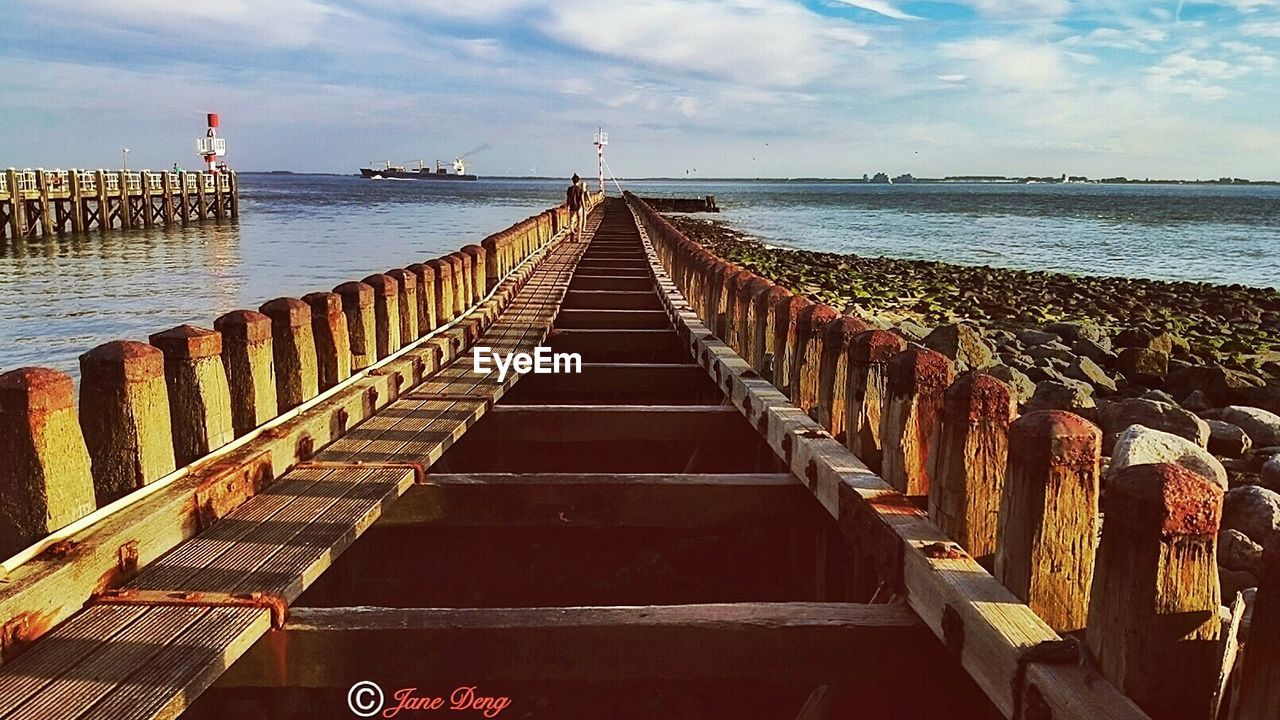 sea, water, horizon over water, sky, cloud - sky, beach, outdoors, day, nature, beauty in nature, tranquility, scenics, groyne, no people