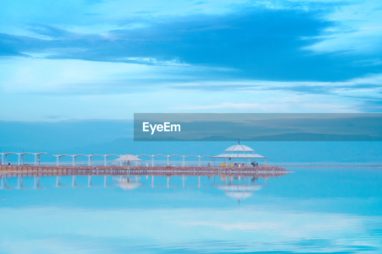 cloud - sky, sky, water, no people, waterfront, blue, nature, sea, built structure, architecture, scenics - nature, beauty in nature, tranquility, reflection, tranquil scene, day, outdoors, building exterior, travel destinations