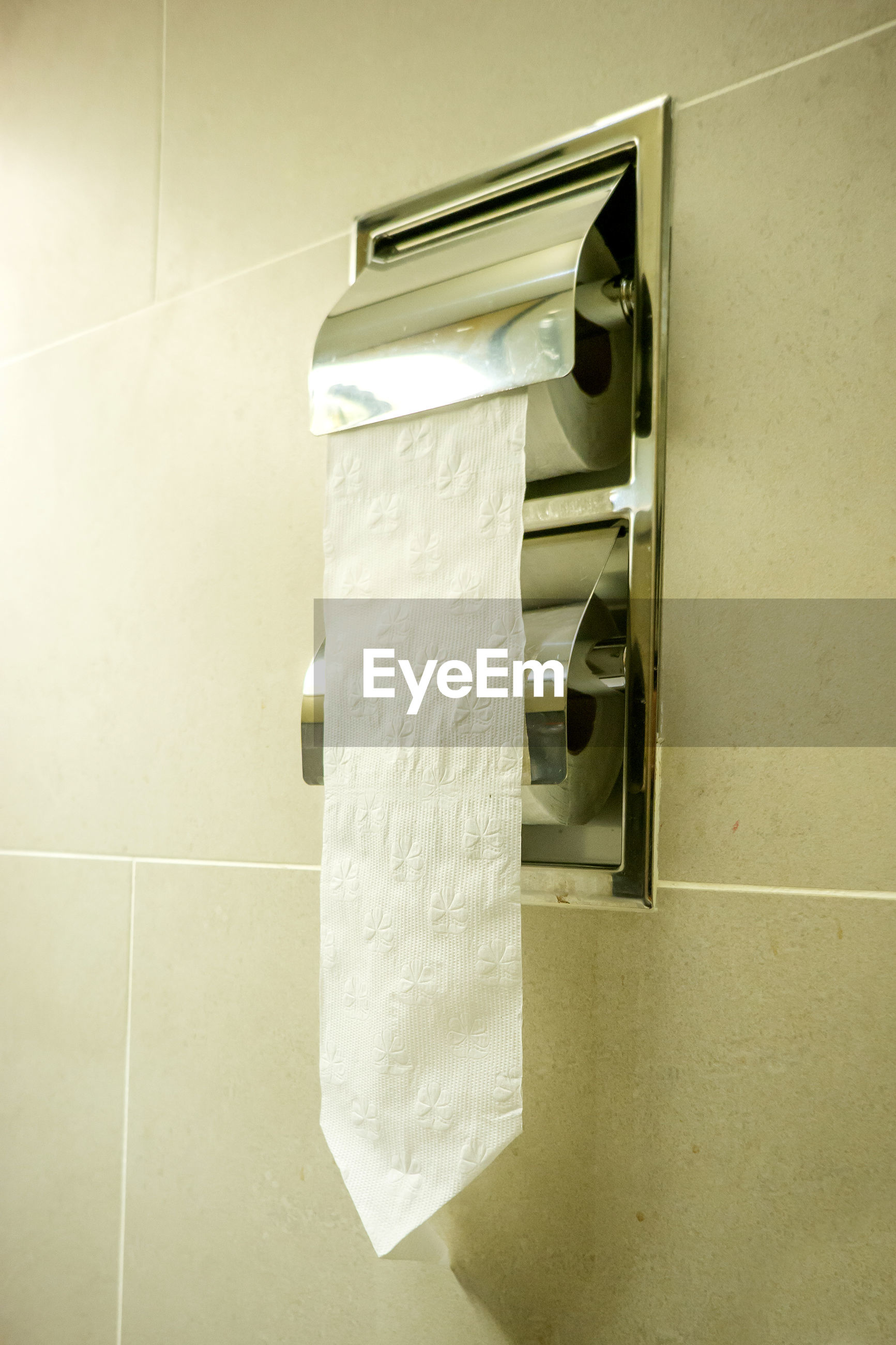 Close-up of toilet paper in bathroom