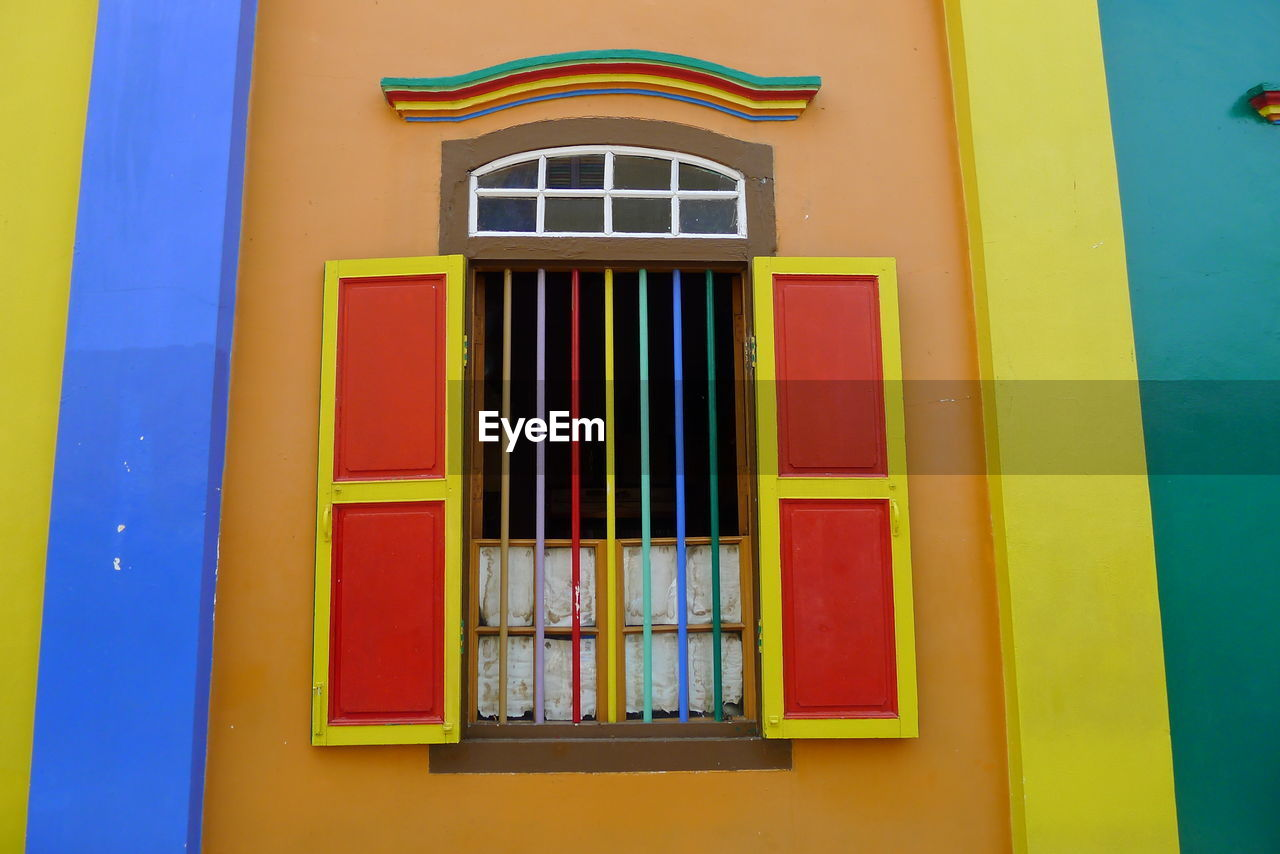 window, multi colored, architecture, built structure, no people, building exterior, day, yellow, blue, outdoors, close-up