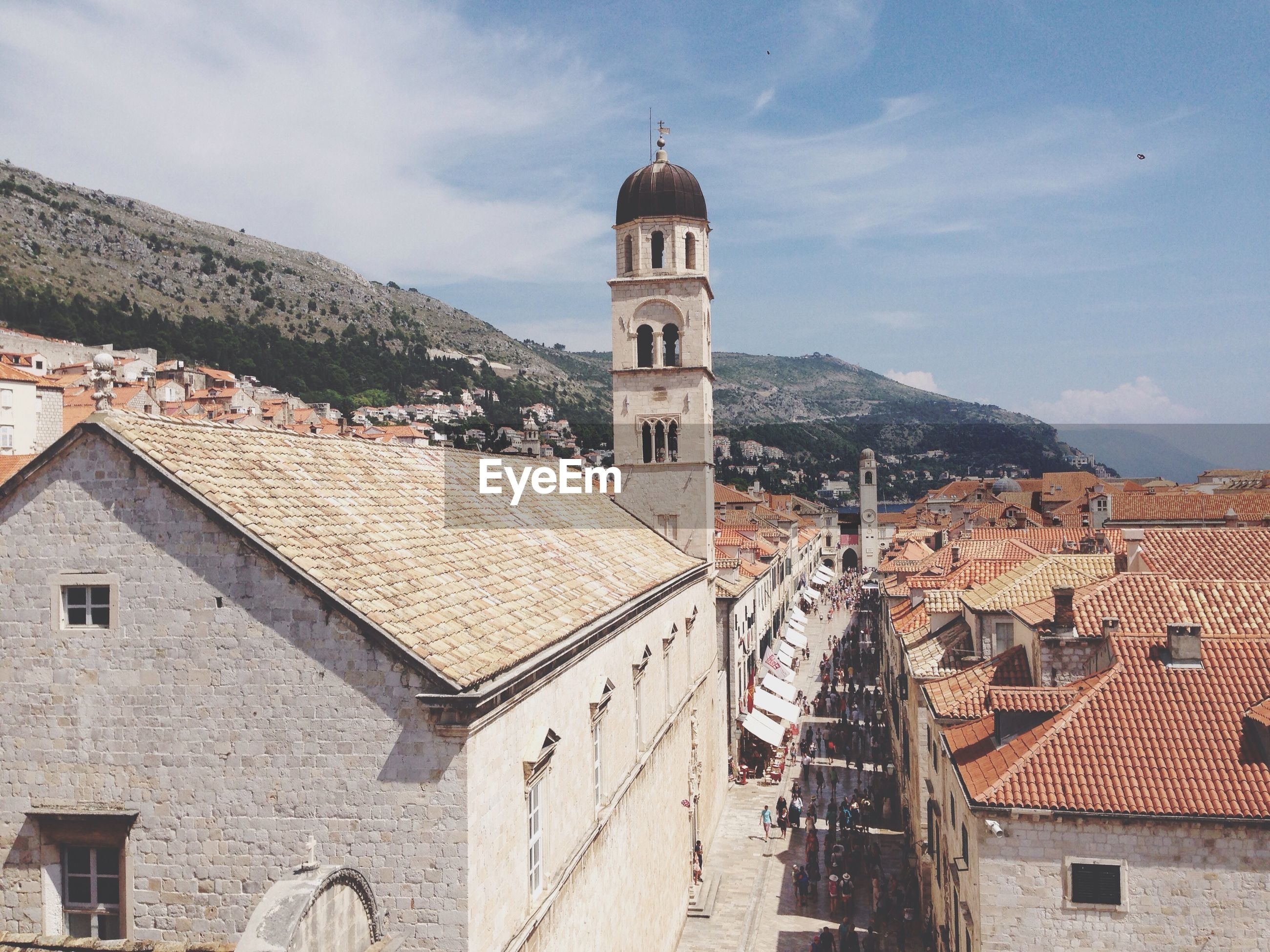 building exterior, architecture, built structure, church, place of worship, religion, spirituality, sky, cathedral, roof, old town, house, residential structure, dome, town, residential building, tower, day