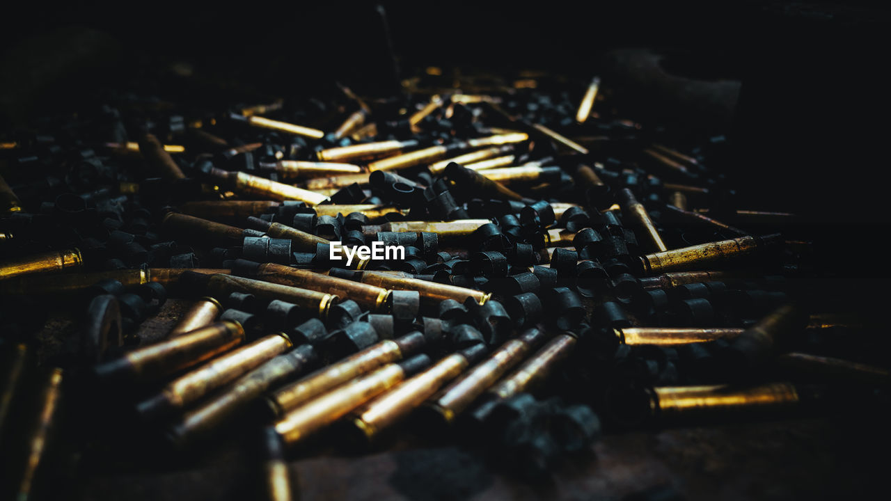 High Angle View Of Bullets On Floor