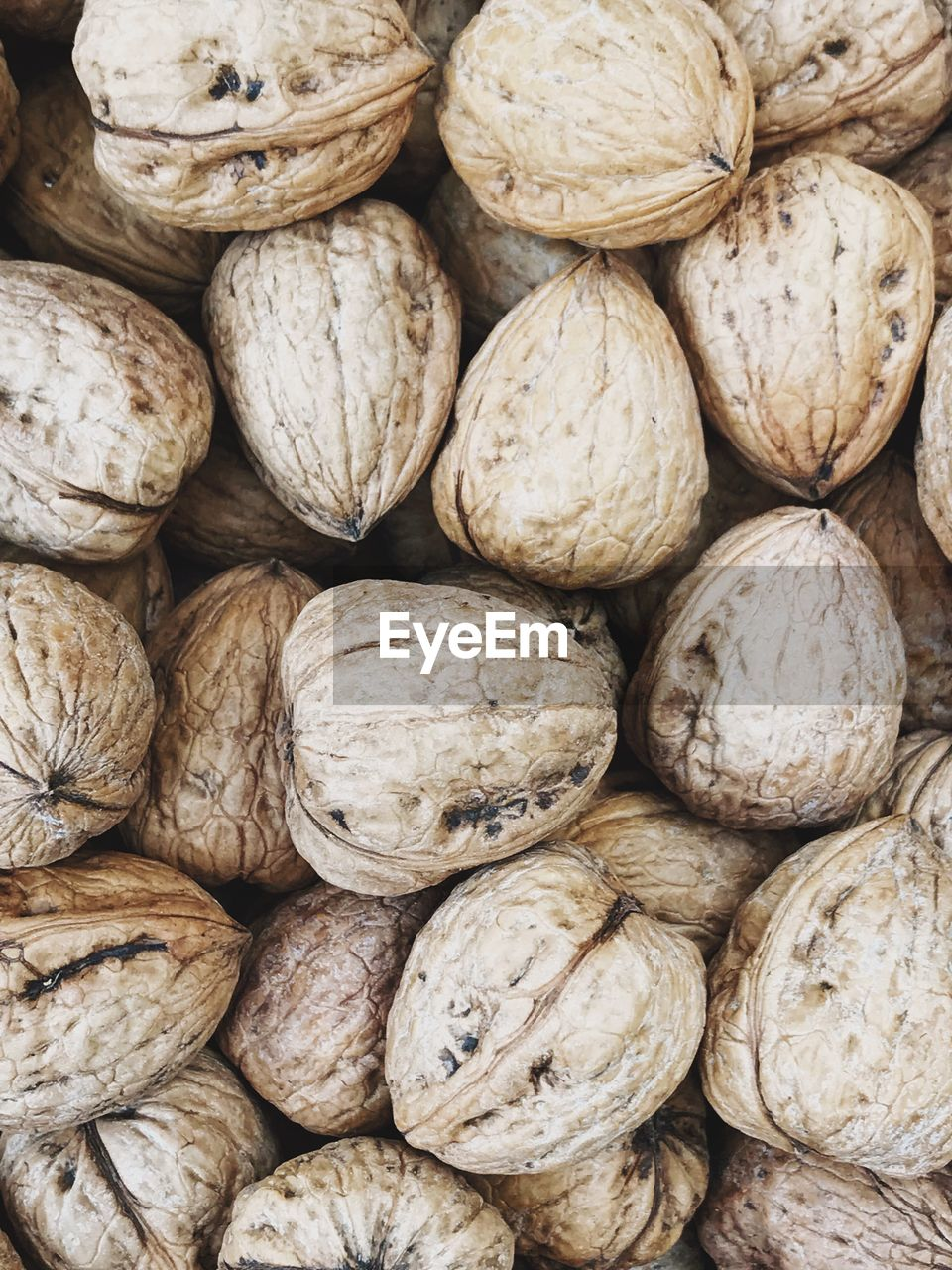 food and drink, large group of objects, full frame, backgrounds, abundance, freshness, food, still life, wellbeing, healthy eating, market, for sale, retail, no people, close-up, walnut, market stall, heap, nut, textured, sale