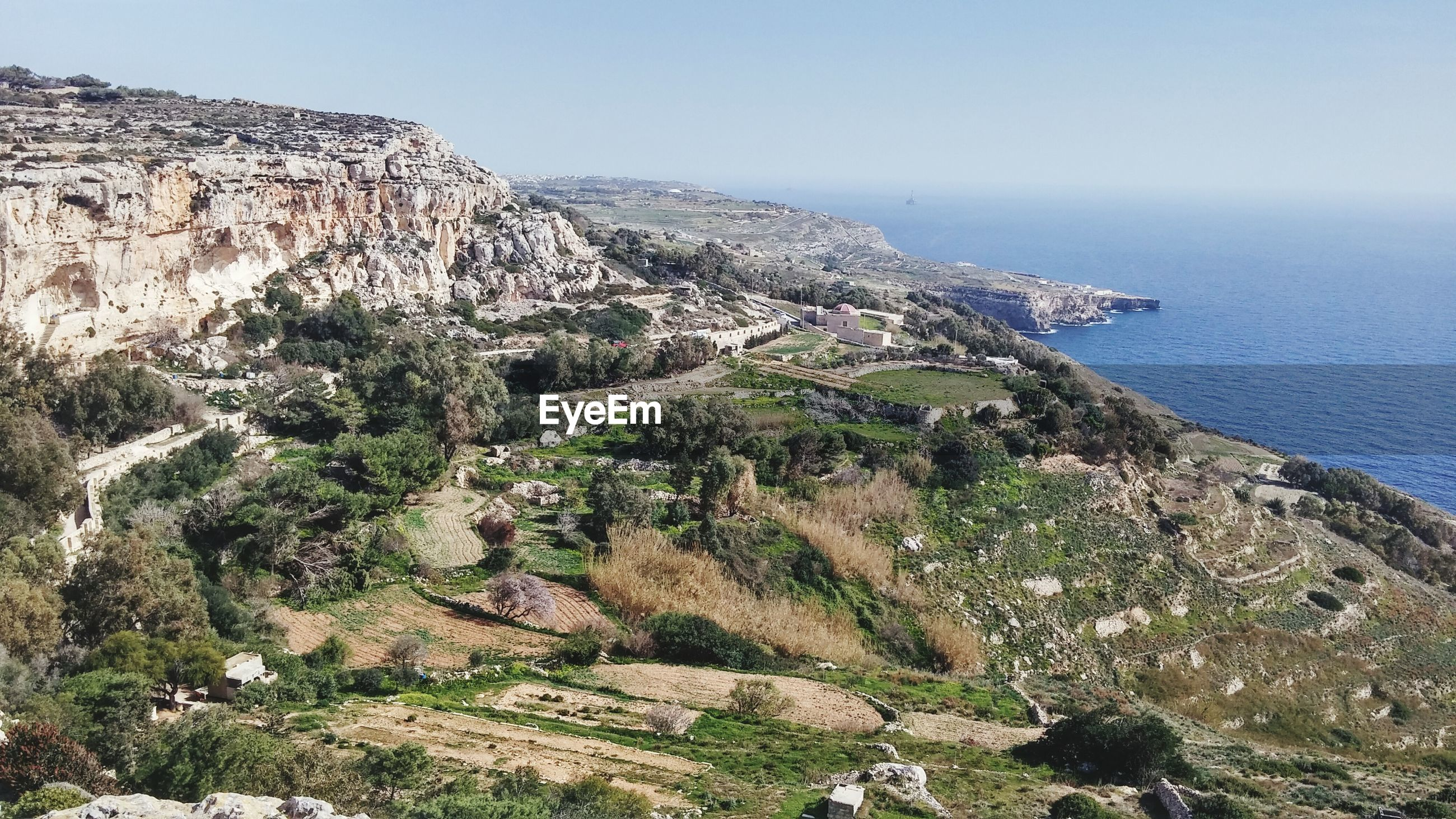 High angle view of countryside landscape against the sea