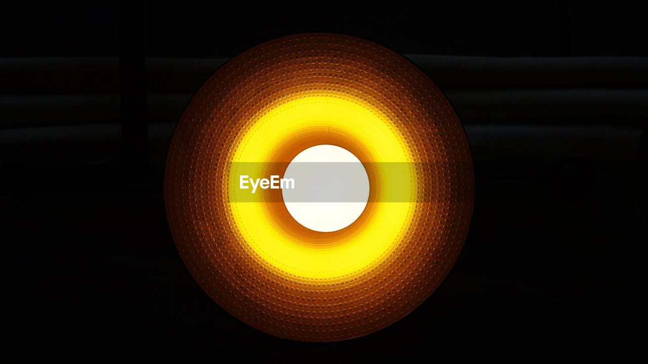 orange color, illuminated, lighting equipment, no people, glowing, black background, indoors, electricity, yellow, close-up, light bulb, night