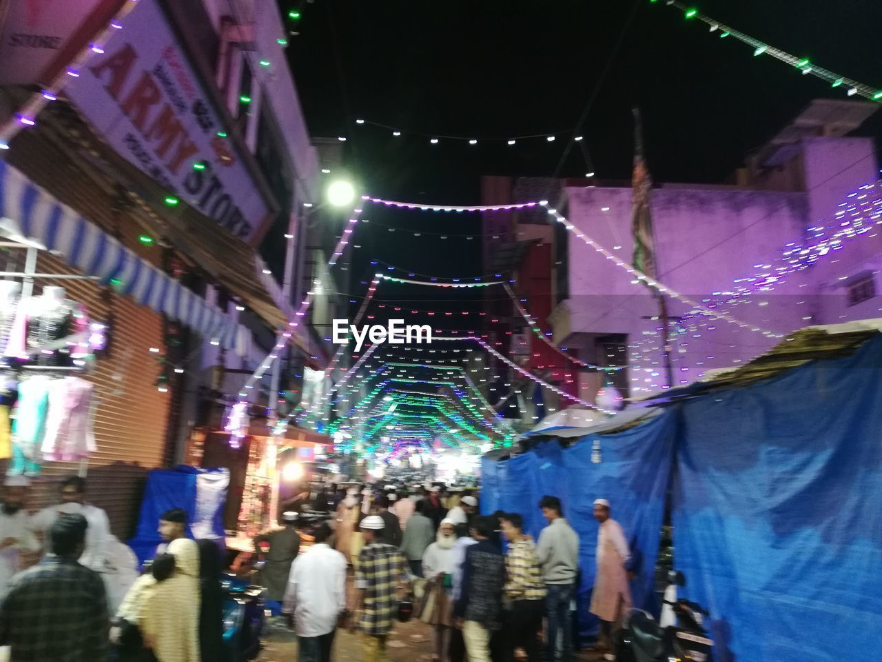 night, illuminated, real people, group of people, crowd, large group of people, decoration, architecture, women, city, adult, men, built structure, celebration, building exterior, lighting equipment, lifestyles, low angle view, light, nightlife, festival, stage