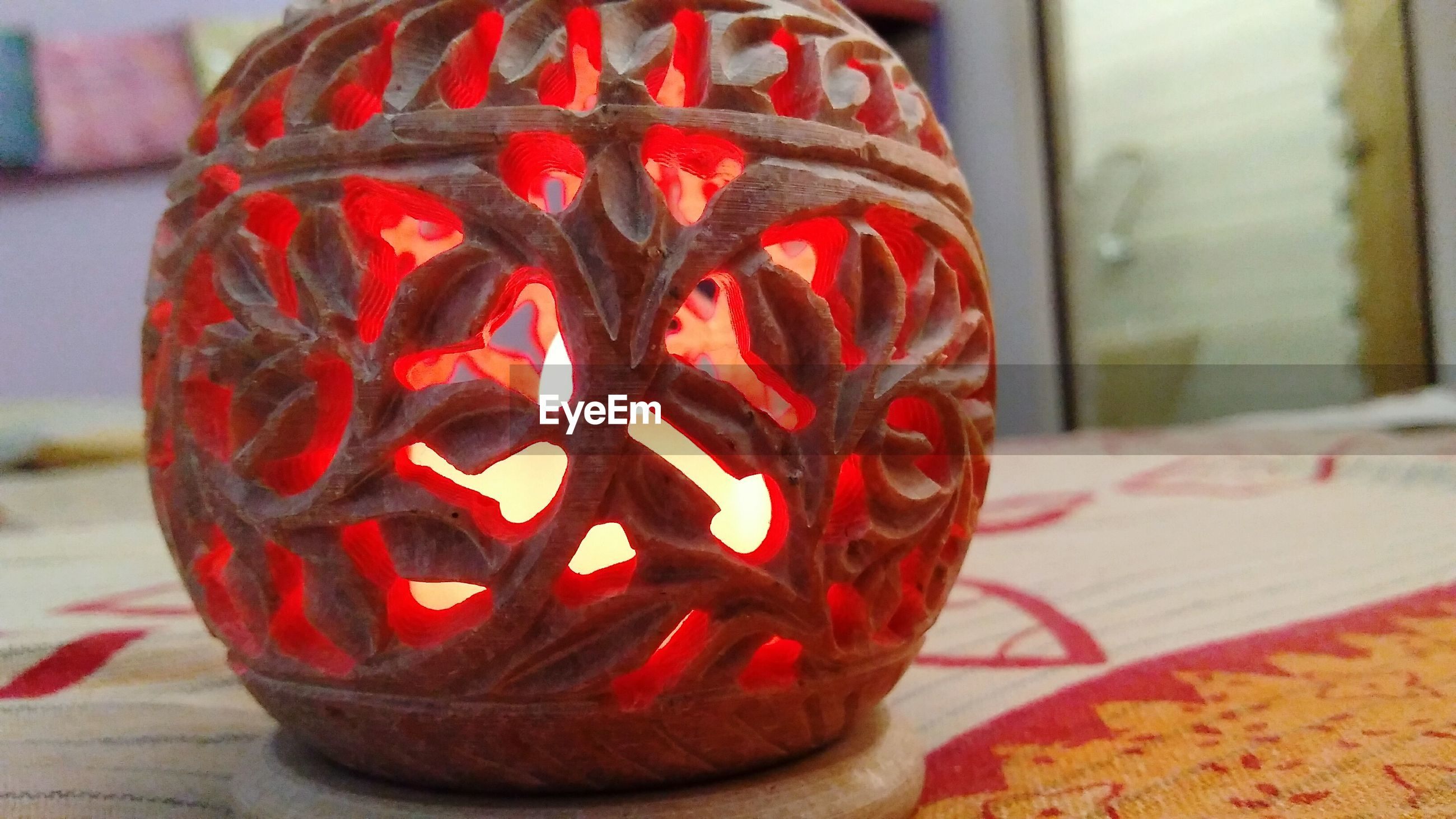 red, anthropomorphic face, no people, close-up, indoors, pumpkin, jack o lantern, day