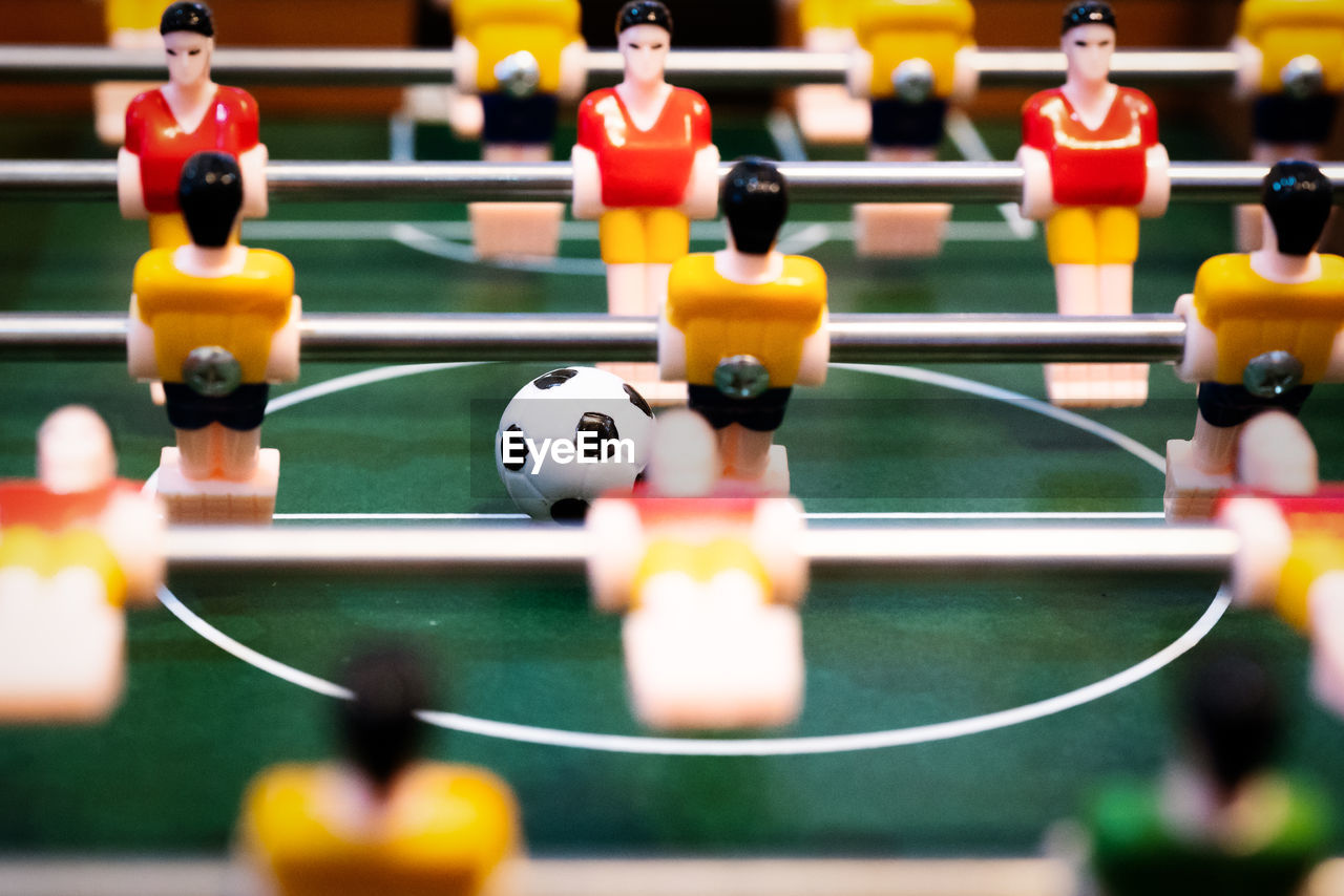 sport, leisure games, team sport, competition, leisure activity, soccer, relaxation, figurine, competitive sport, male likeness, close-up, human representation, table, playing, teamwork, cooperation, taking a shot - sport, shooting at goal, selective focus, challenge, no people, sports activity