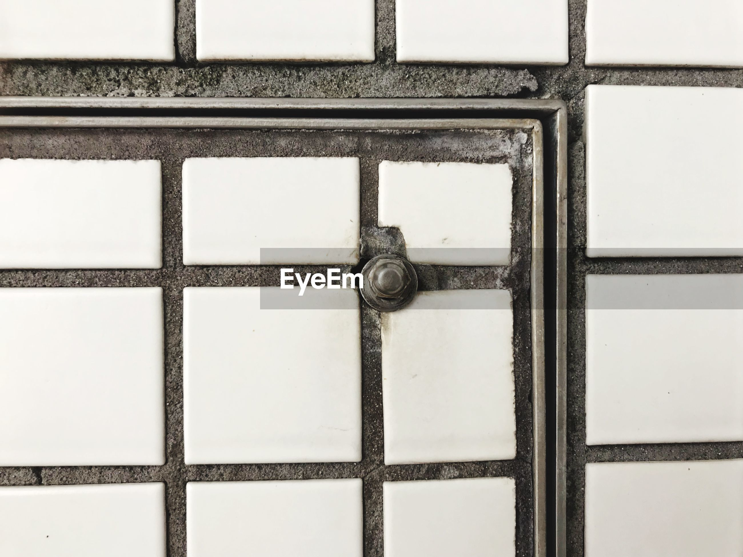 FULL FRAME SHOT OF METAL DOOR WITH TEXT ON WALL